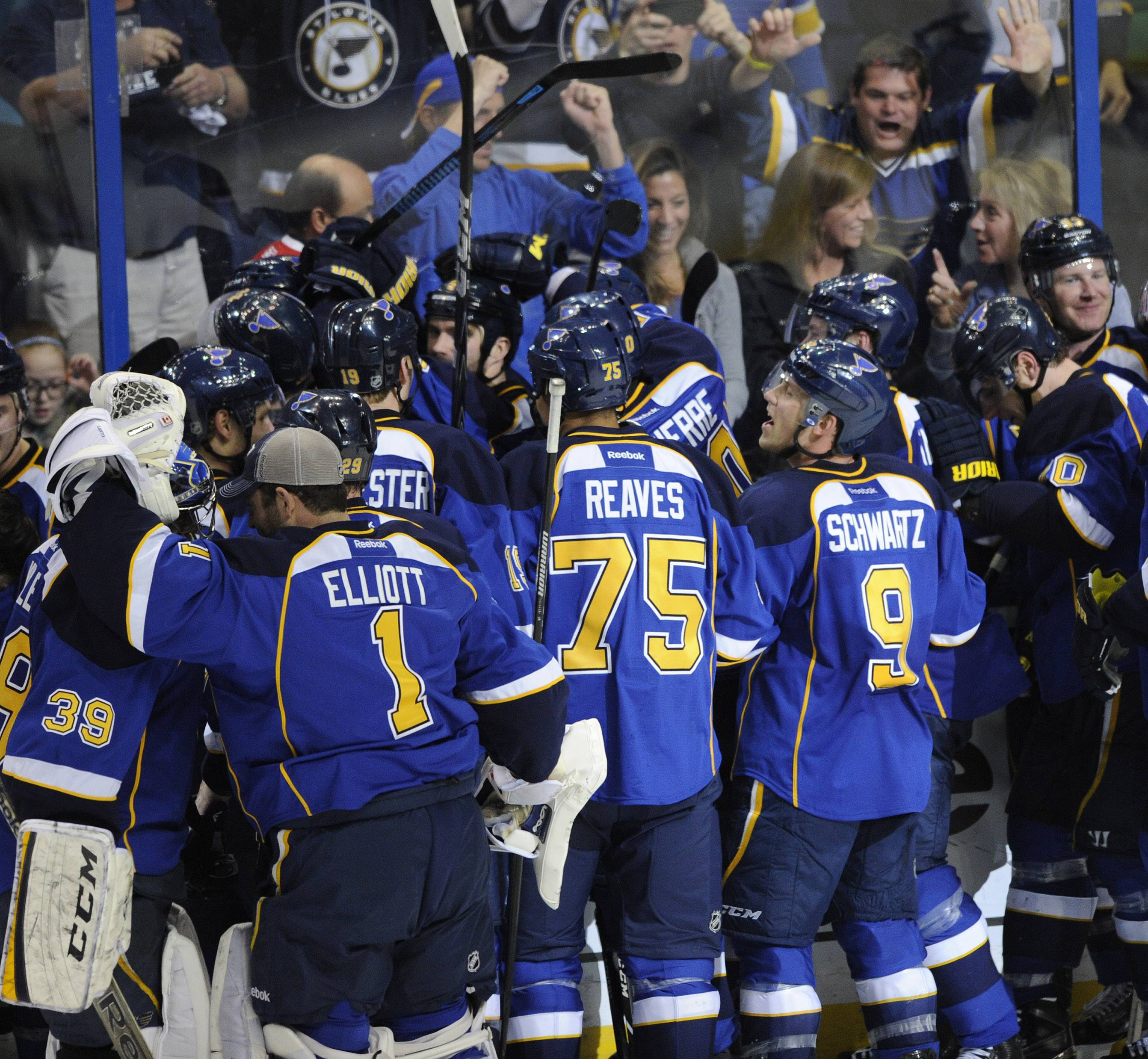 St. Louis Blues surround teammate Barret Jackman, center, after his game-winning goal against the Chicago Blackhawks during overtime in Game 2 of a first-round NHL hockey playoff series, Saturday, April 19, 2014, in St. Louis.