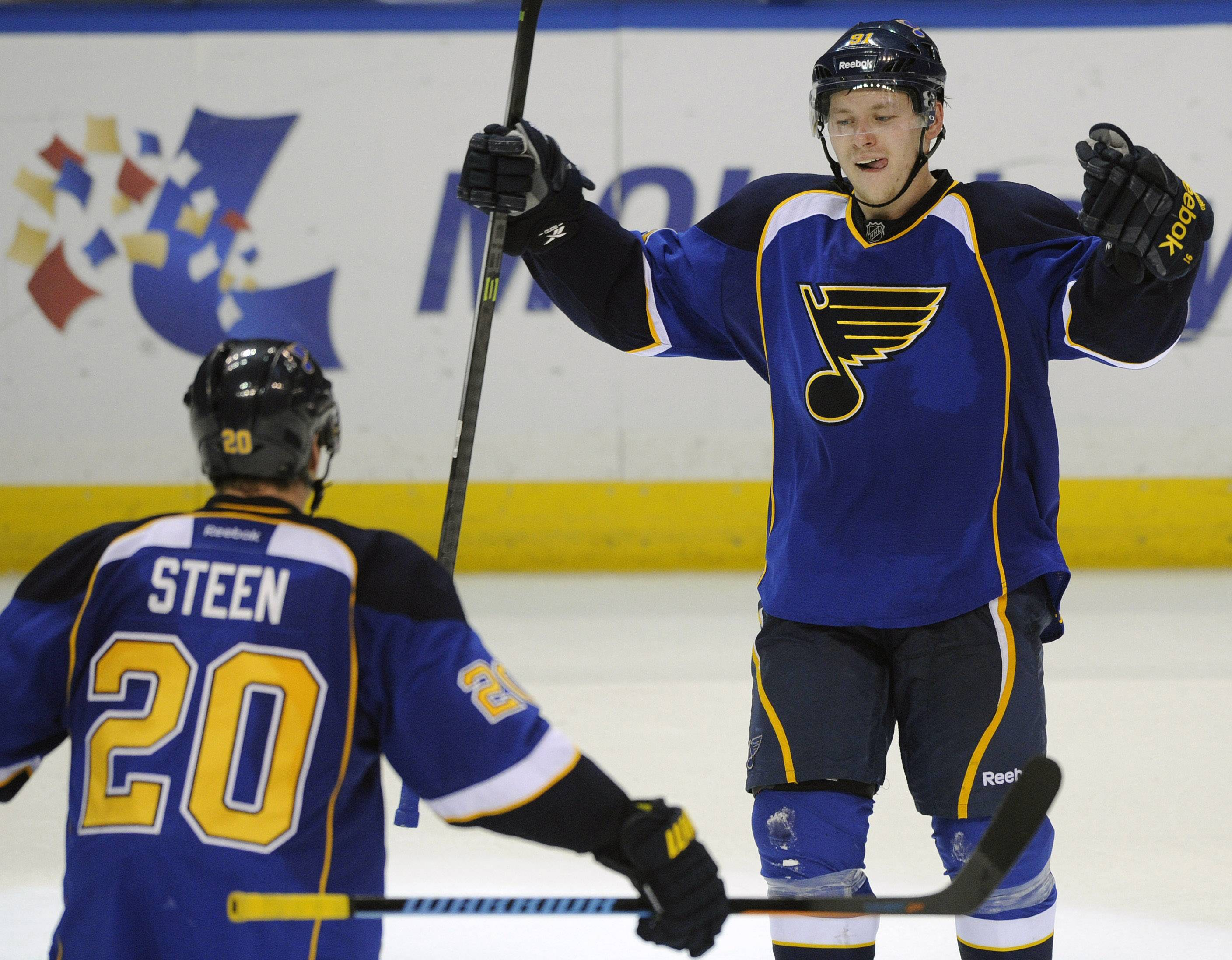 St. Louis Blues' Vladimir Tarasenko (91), of Russia, celebrates with teammate Alexander Steen (20) after his game-tying goal against the Chicago Blackhawks during the third period in Game 2 of a first-round NHL hockey playoff series, Saturday, April 19, 2014, in St. Louis.