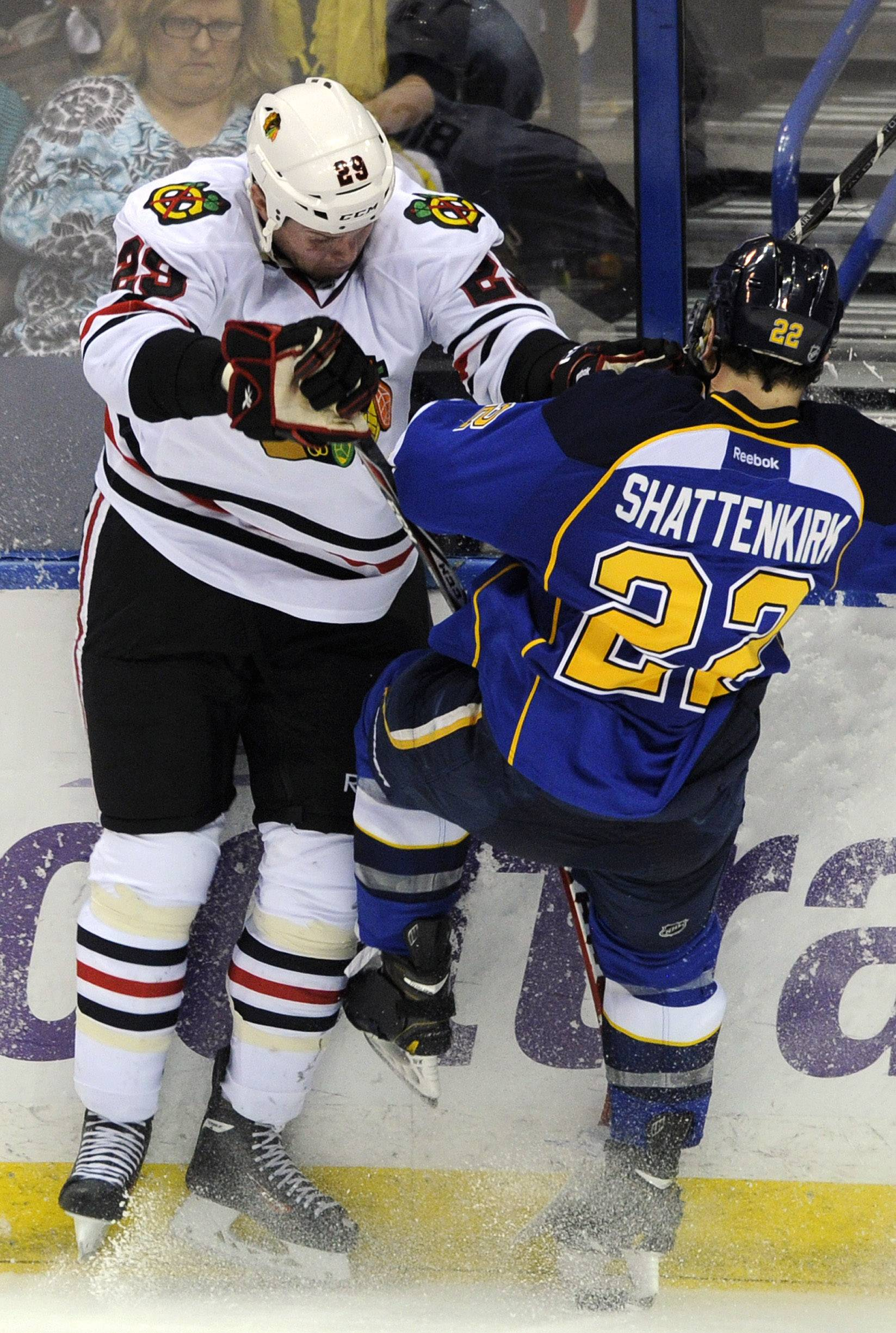 St. Louis Blues' Kevin Shattenkirk (22) collides with Chicago Blackhawks' Bryan Bickell (29) during the third period in Game 2 of a first-round NHL hockey playoff series, Saturday, April 19, 2014, in St. Louis.