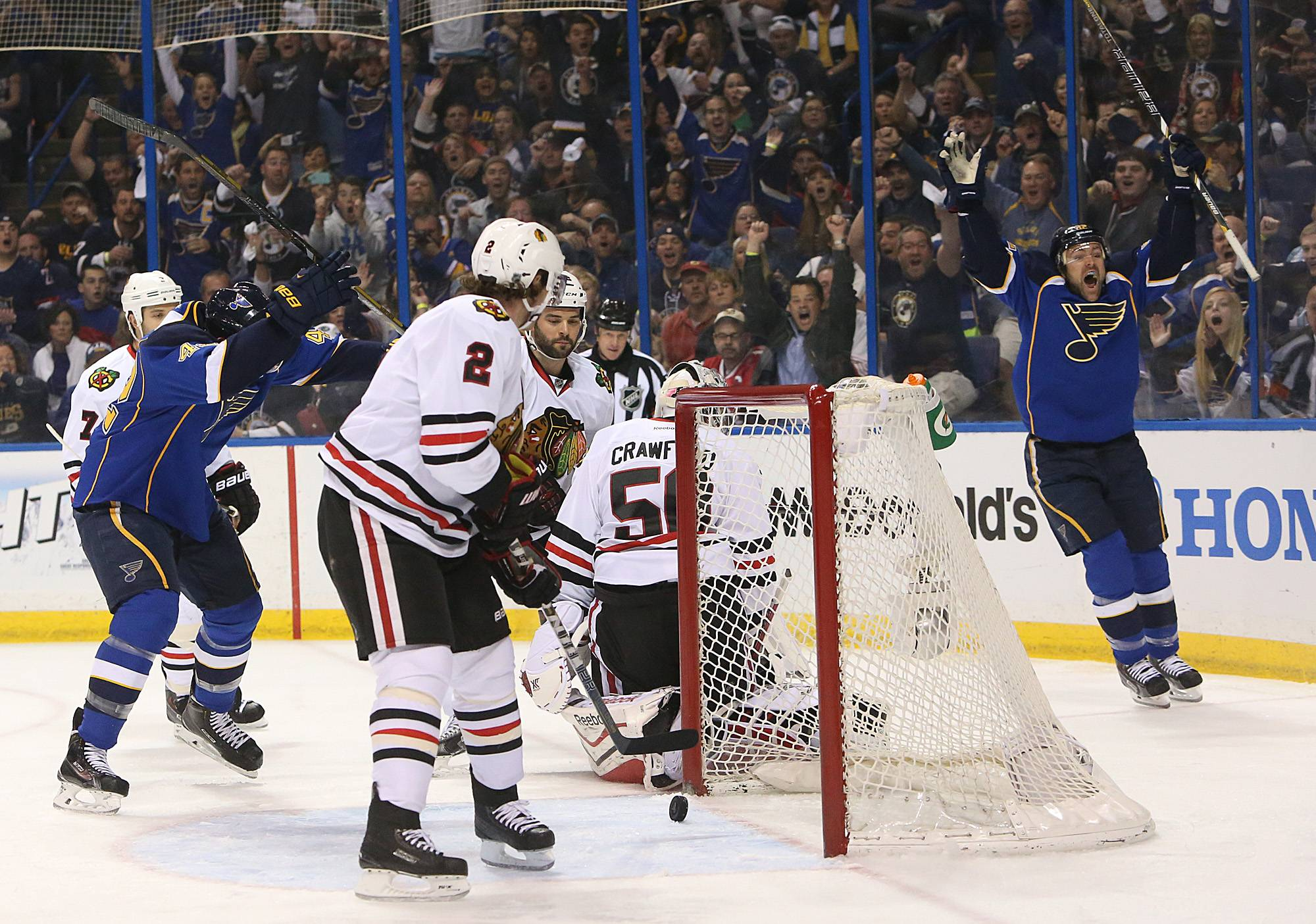 St. Louis Blues left wing Chris Porter, right, reacts after scoring the first goal in the first period of Game 2 of a first-round NHL hockey playoff series against the Chicago Blackhawks, Saturday, April 19, 2014, in St. Louis.