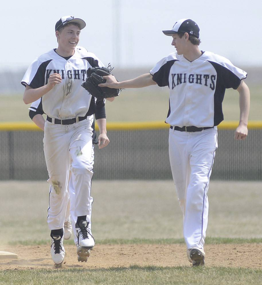 Kaneland's Nick Stratman, left, is congratulated by teammate Nate Hopkins on catching the final out for Geneva in the top of the ninth inning on Saturday, April 19.
