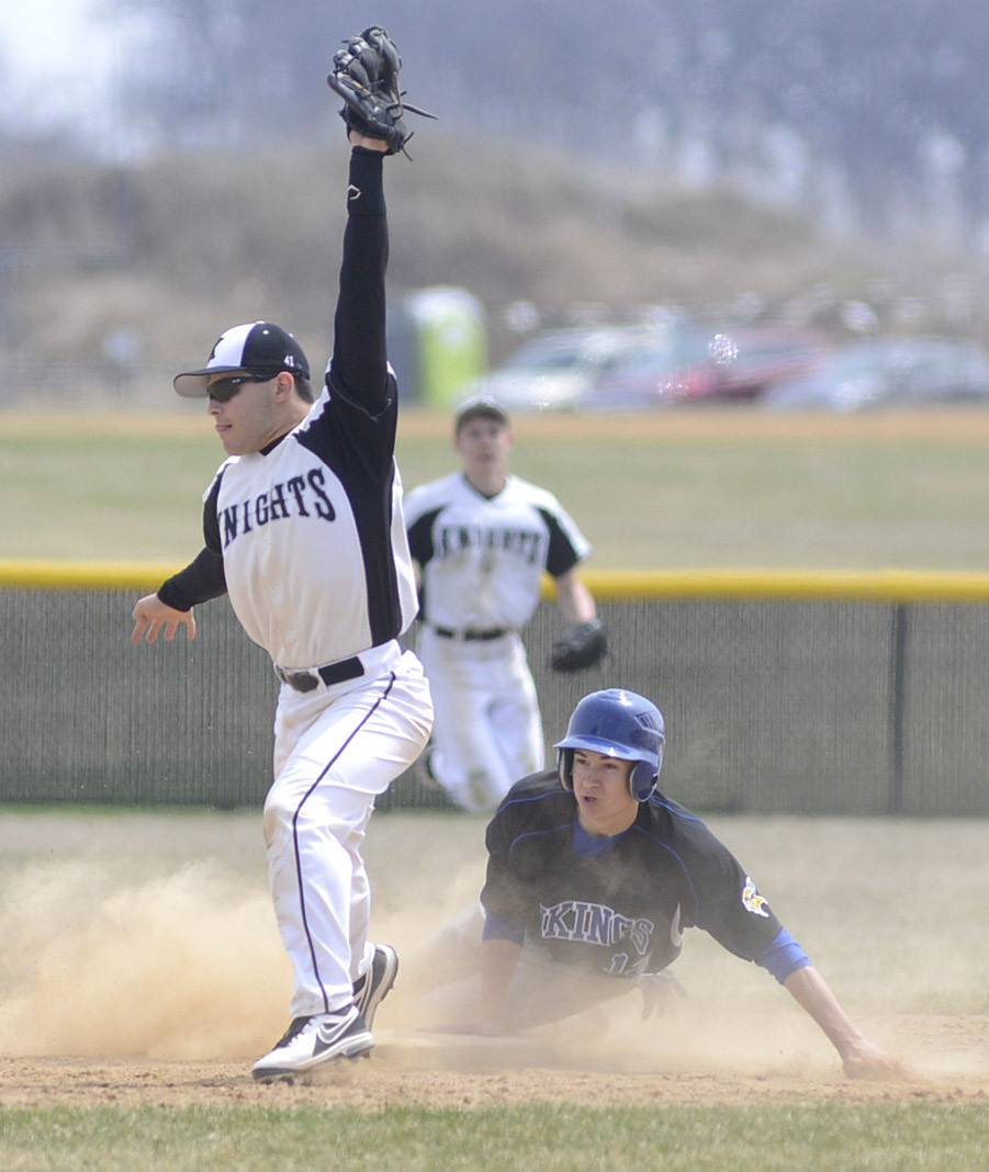 Geneva's Brandon Evert is safe on second base from Kaneland's Joe Panico in the ninth inning on Saturday, April 19.