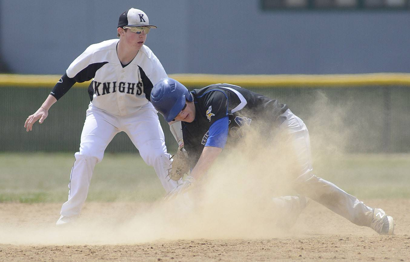 Kaneland's Jake Bilotta tags out Geneva's Nathan Montgomery at second base in the fifth inning on Saturday, April 19.