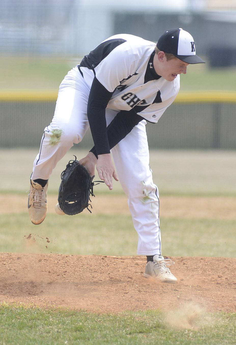 Kaneland's Nick Stahl tries to catch a hit off the bat as it flies between his legs and past his glove in the eighth inning on Saturday, April 19.
