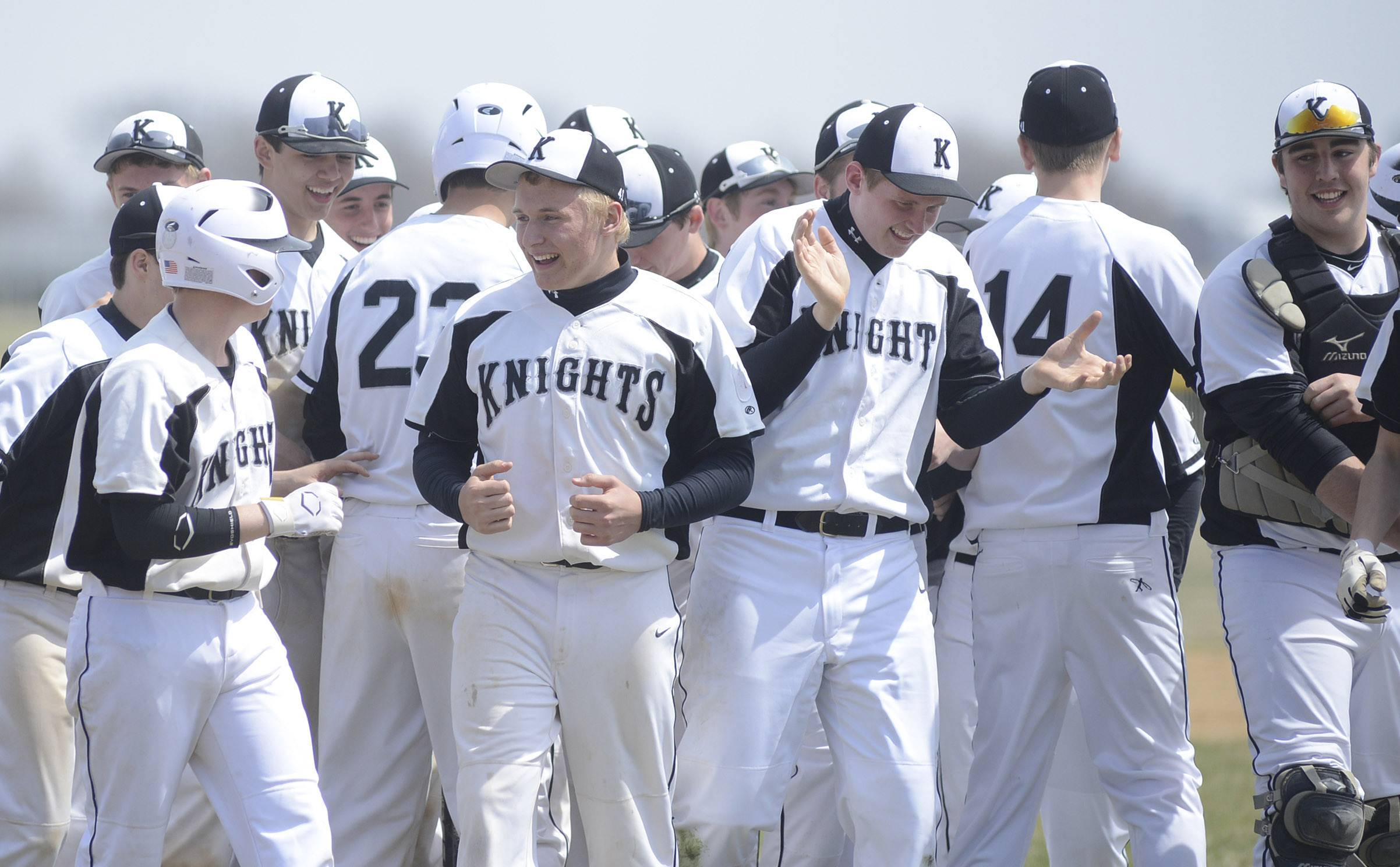 Kaneland's Nick Henne, center, celebrates with the Knights after their tie-breaking win over Geneva in the ninth inning on Saturday, April 19. Henne was the Knights' final pitcher of the game.