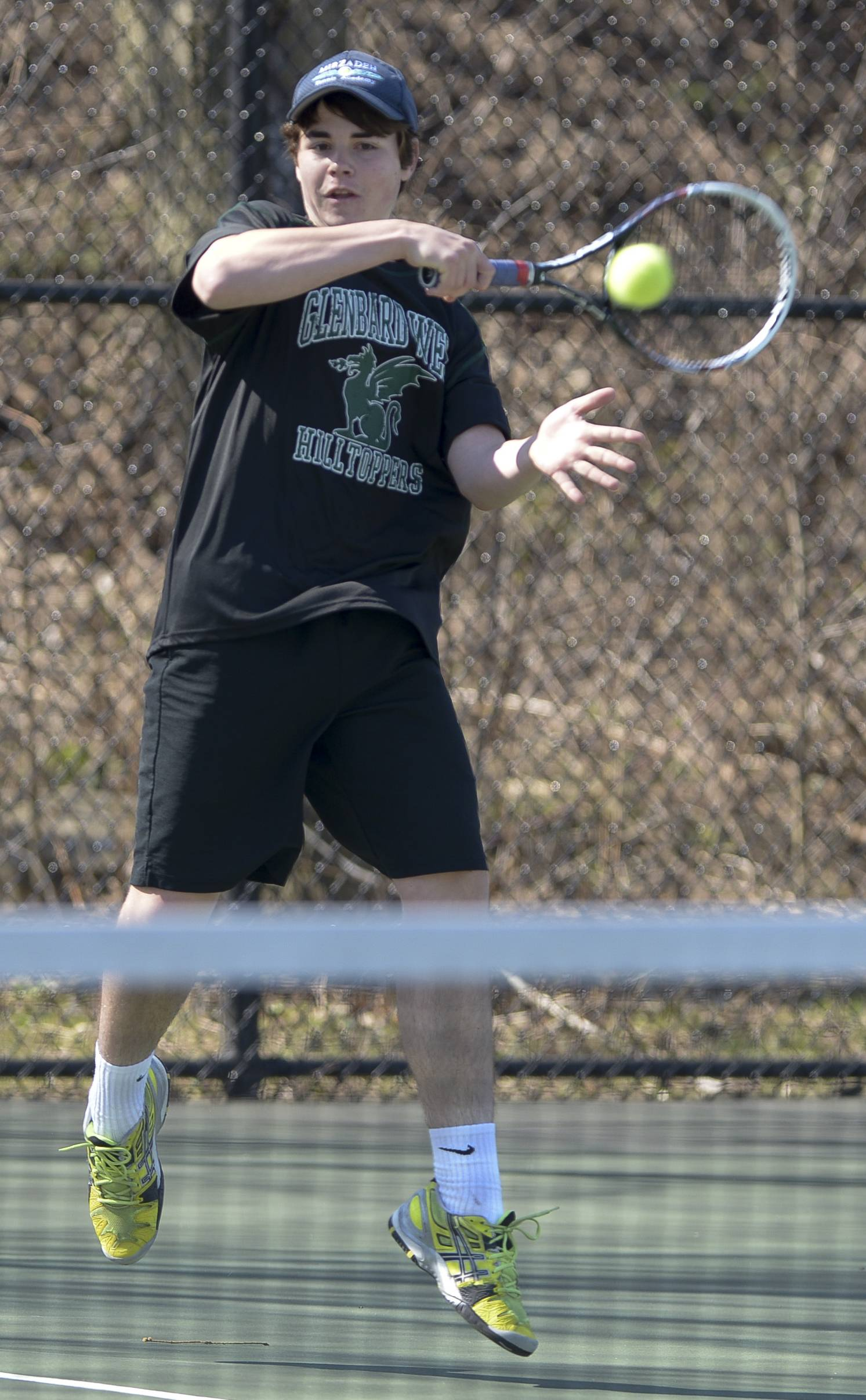 Glenbard West's Nate Dell completes against Palatine's Mark Scovic during the Glenbard West boys tennis invitational.
