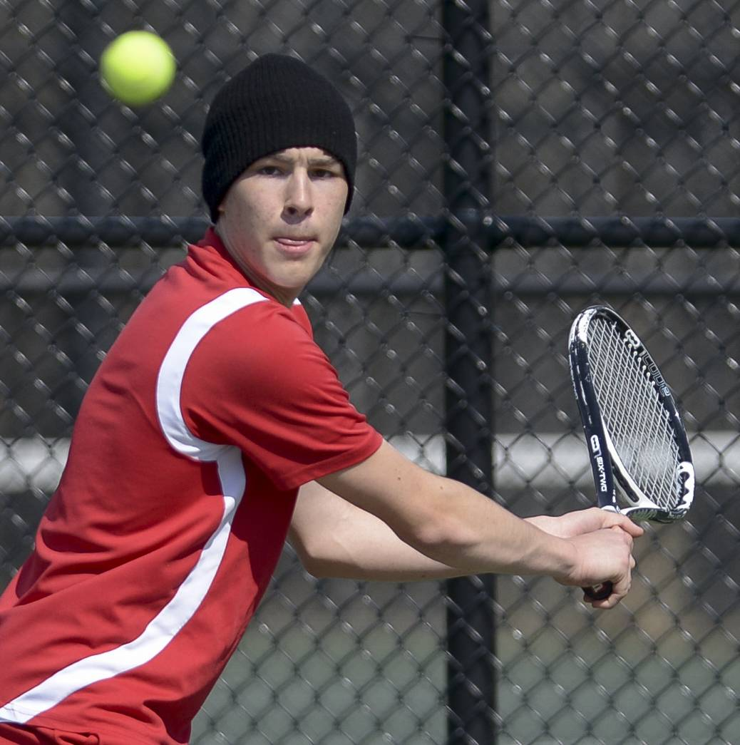 Glenbard South's Joe Meade completes against Glenbard East's Nathan Delawder during the Glenbard West boys tennis invitational.