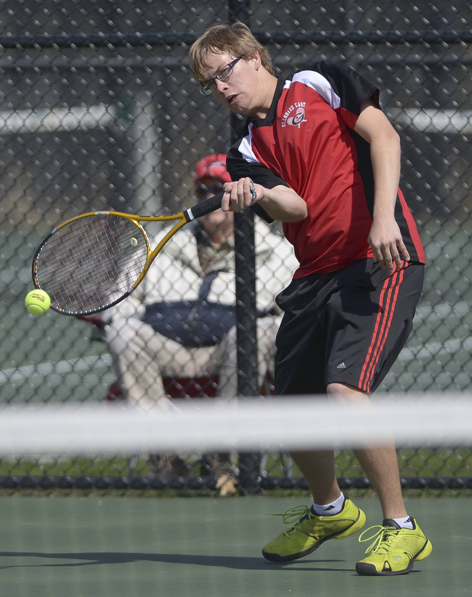 Glenbard East's Nathan Delawder completes against Glenbard South's Joe Meade during the Glenbard West boys tennis invitational.