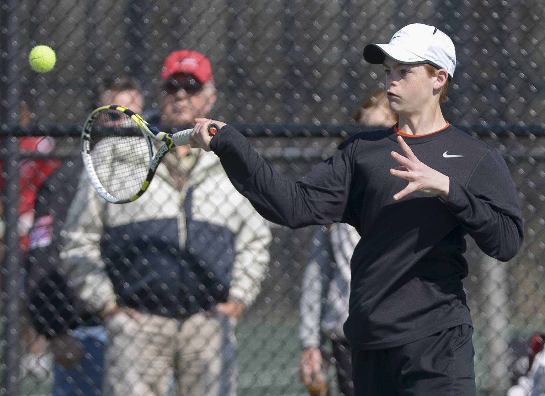 Wheaton Warrenville South's Charlie McDonough completes against Glenbard East's Nathan Delawder during the Glenbard West boys tennis invitational.