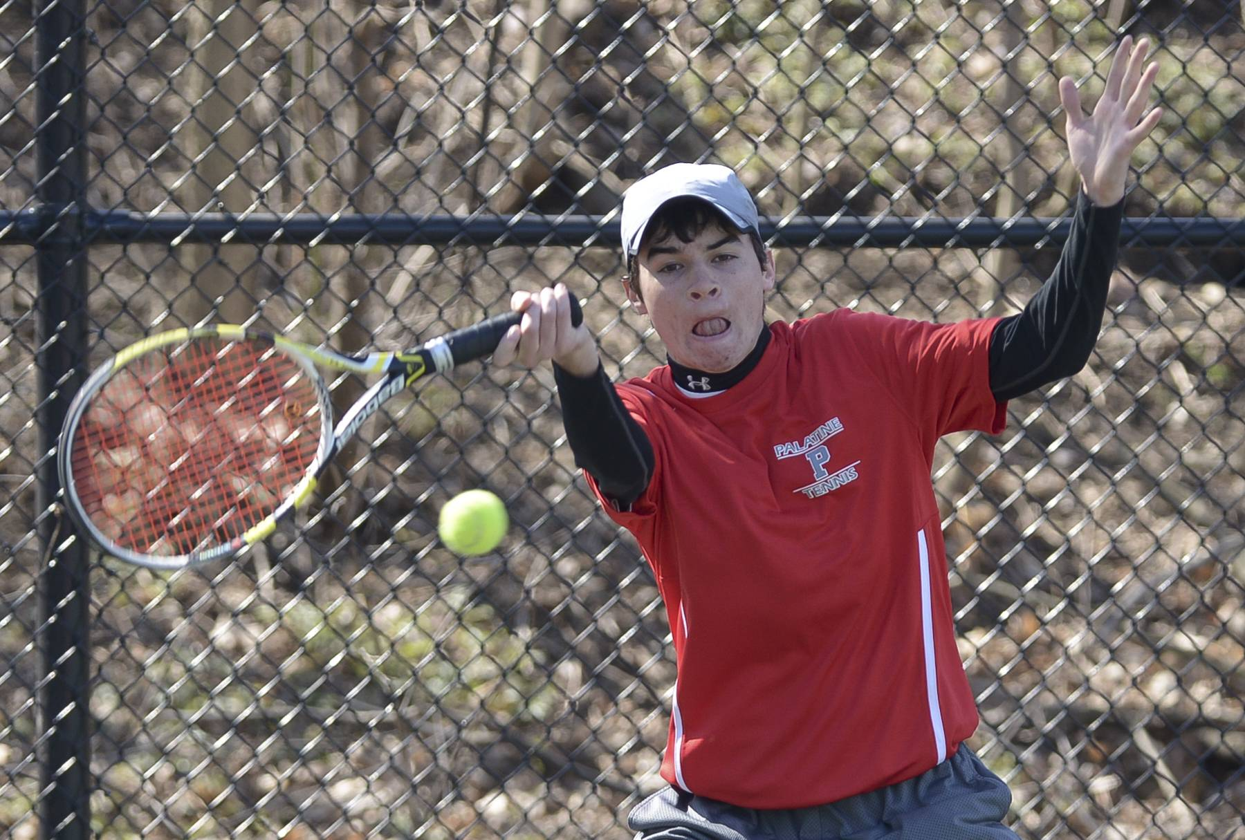 Palatine's Mark Scovic completes against Glenbard West's Nate Dell during the Glenbard West boys tennis invitational.