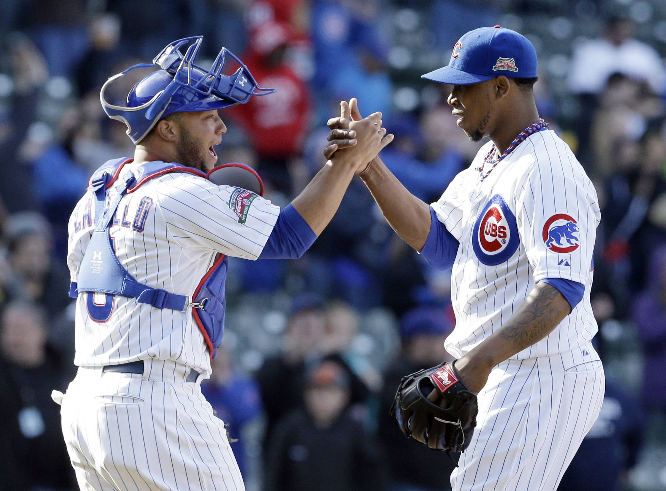 Cubs relief pitcher Pedro Strop, right, celebrates with catcher Welington Castillo after the Cubs defeated the Cincinnati Reds 8-4 Saturday at Wrigley Field.