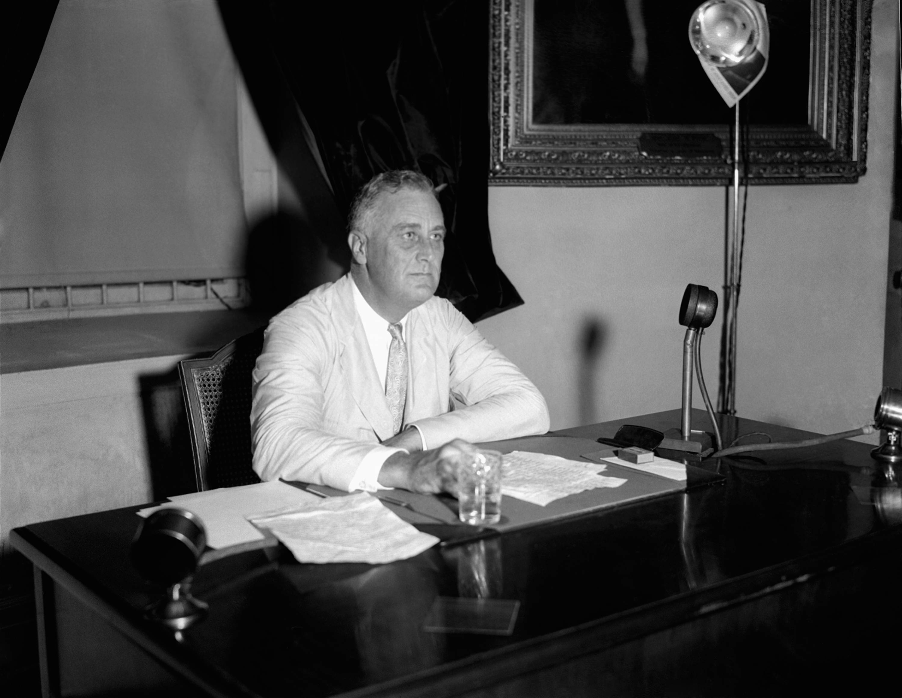 This July 24, 1933 file photo shows President Franklin D. Roosevelt appealing to the nation via radio for immediate enrollment of all employers under the blanket agreement to raise wages and create jobs, in Washington. When the Senate debates a Democratic proposal to raise the federal minimum wage, some workers won't benefit even if lightning strikes and the long-shot effort prevails.