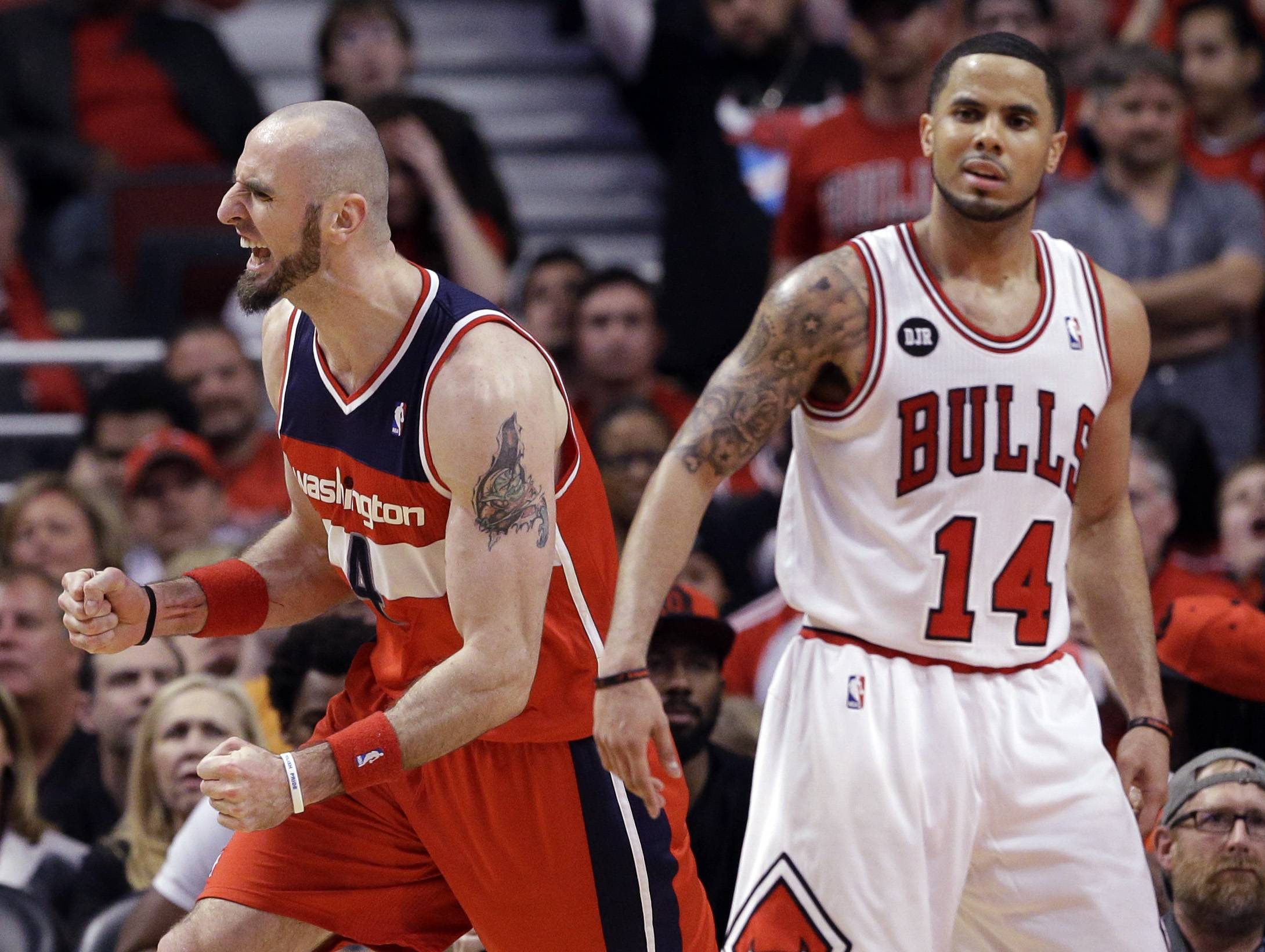 Wizards center Marcin Gortat, left, reacts after scoring a basket as Chicago Bulls guard D.J. Augustin reacts during the second half in Game 1 of an opening-round NBA basketball playoff series in Chicago, Sunday, April 20, 2014. The Wizards won 102-93.