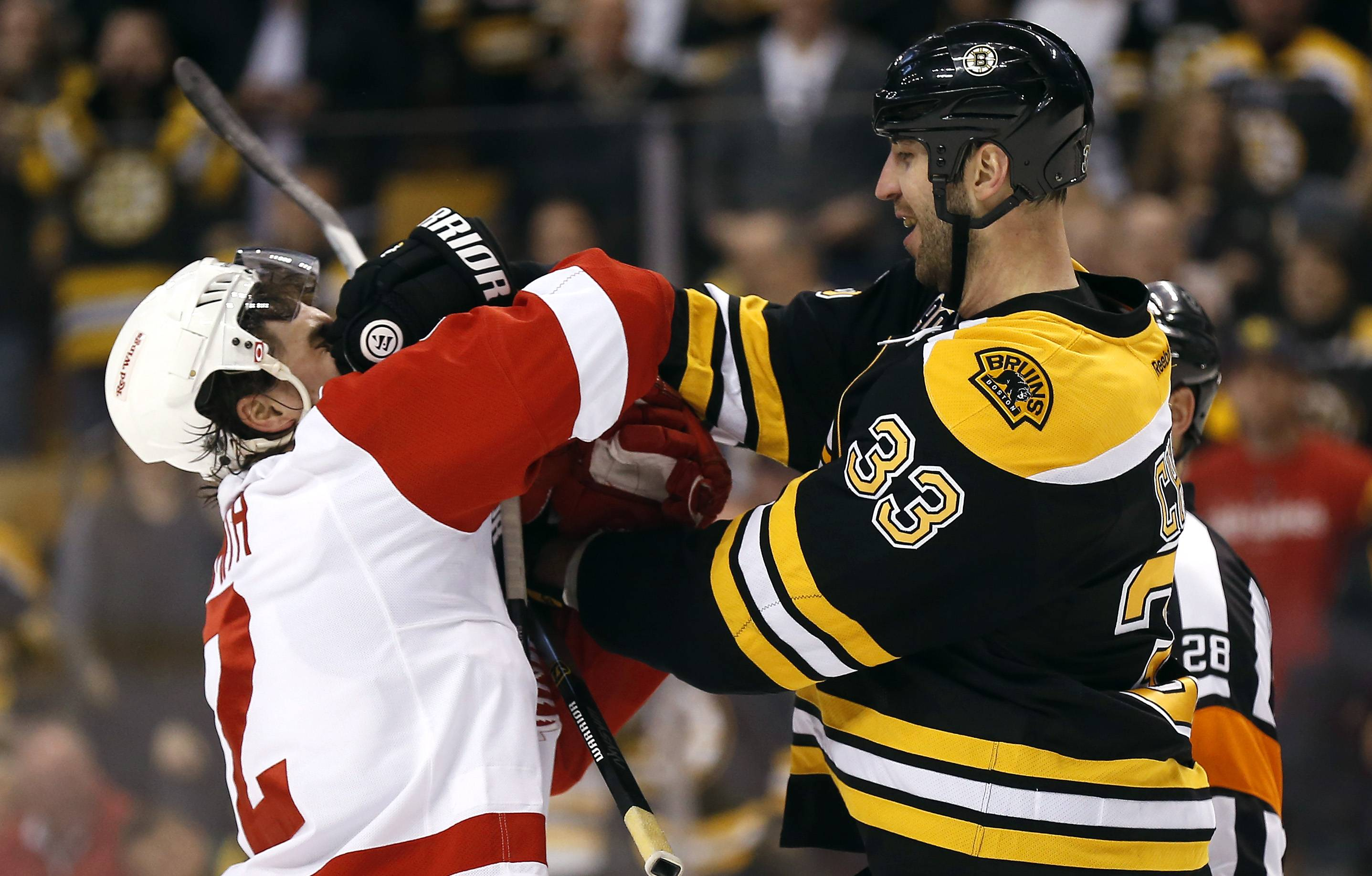 Boston Bruins' Zdeno Chara (33) mixes it up with Detroit Red Wings' Brendan Smith during the first period of Game 2 of a first-round NHL hockey playoff series in Boston, Sunday, April 20, 2014.