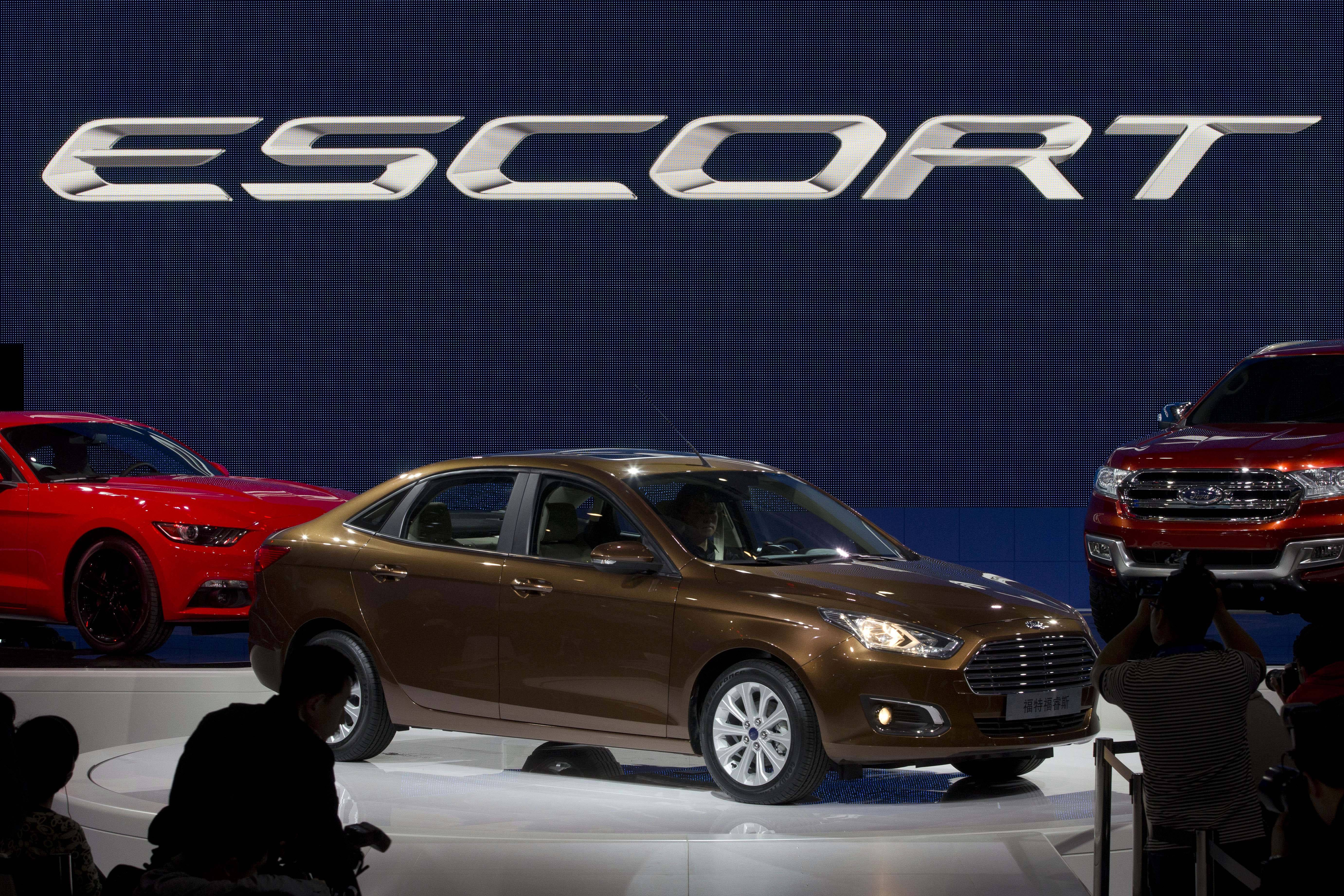 The Ford Escort sedan is unveiled during press day at the China Auto show in Beijing, China, Sunday. Ford unveiled the new Escort sedan designed in China for global sale highlighting the growing influence of Chinese tastes on the industry.