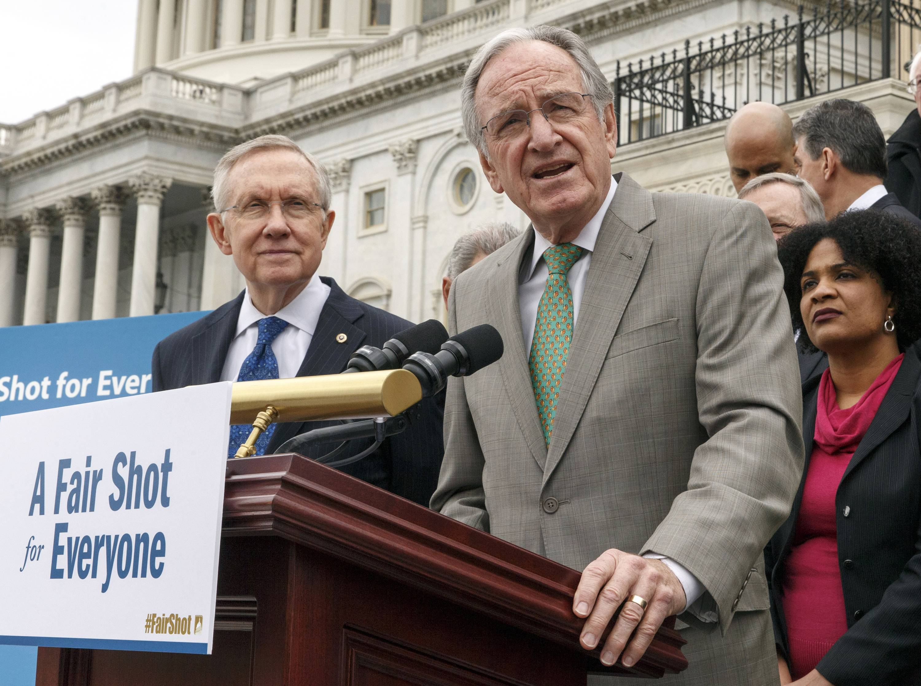 This April 2, 2014 file photo shows Senate Health, Education, Labor and Pensions Committee Chairman Sen. Tom Harkin, D-Iowa, right, accompanied by Senate Majority Leader Harry Reid of Nev., left, and others, urging approval for raising the minimum wage, during a news conference on Capitol Hill in Washington. When the Senate debates a Democratic proposal to raise the federal minimum wage, some workers won't benefit even if lightning strikes and the long-shot effort prevails.