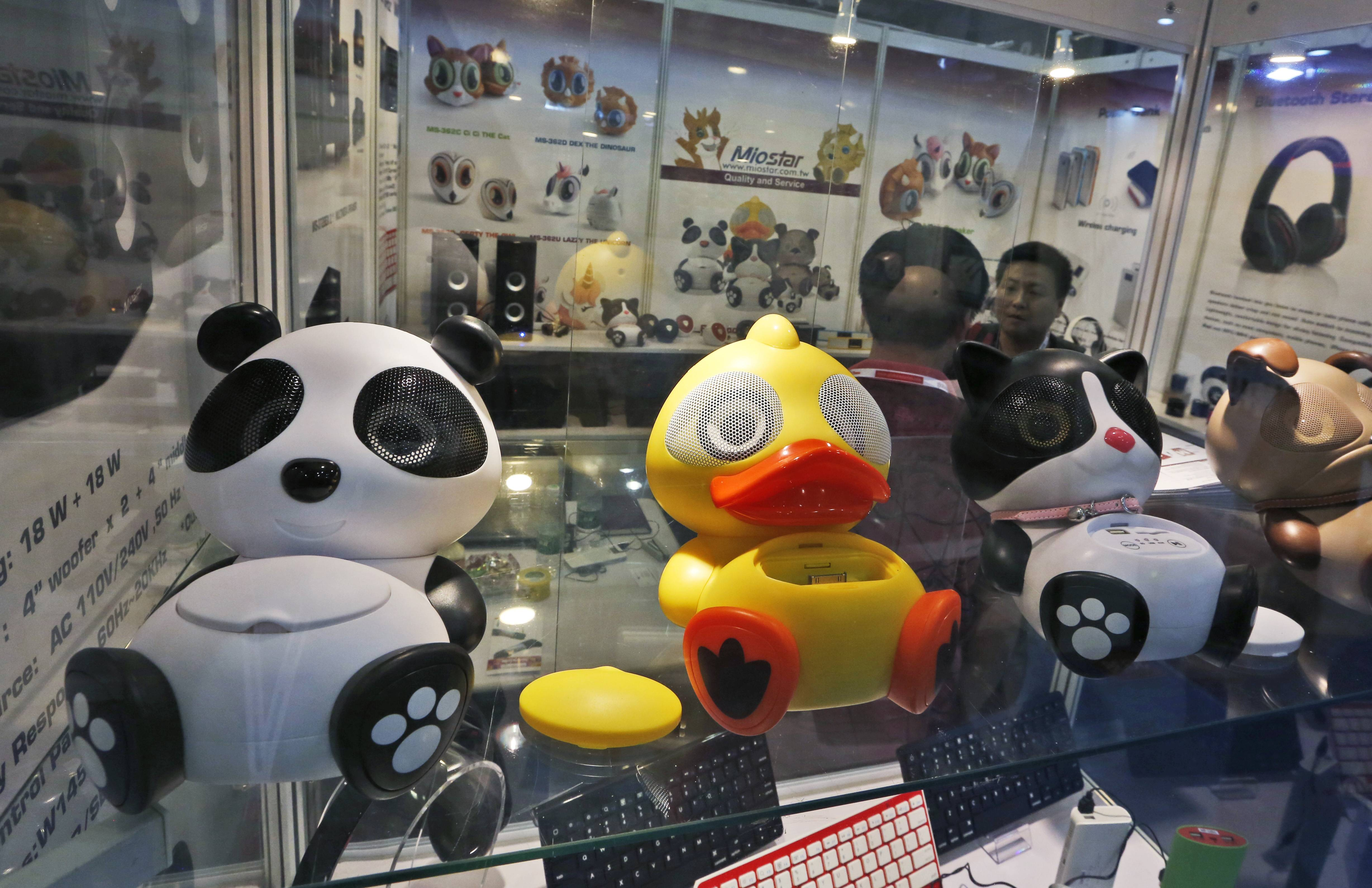 Chinese made smartphone speakers are displayed in a booth at the Global Sources Spring China Sourcing Fair in Hong Kong. As China's economy downshifts, manufacturers are bracing for the turning point that's in store for the world's second biggest economy.