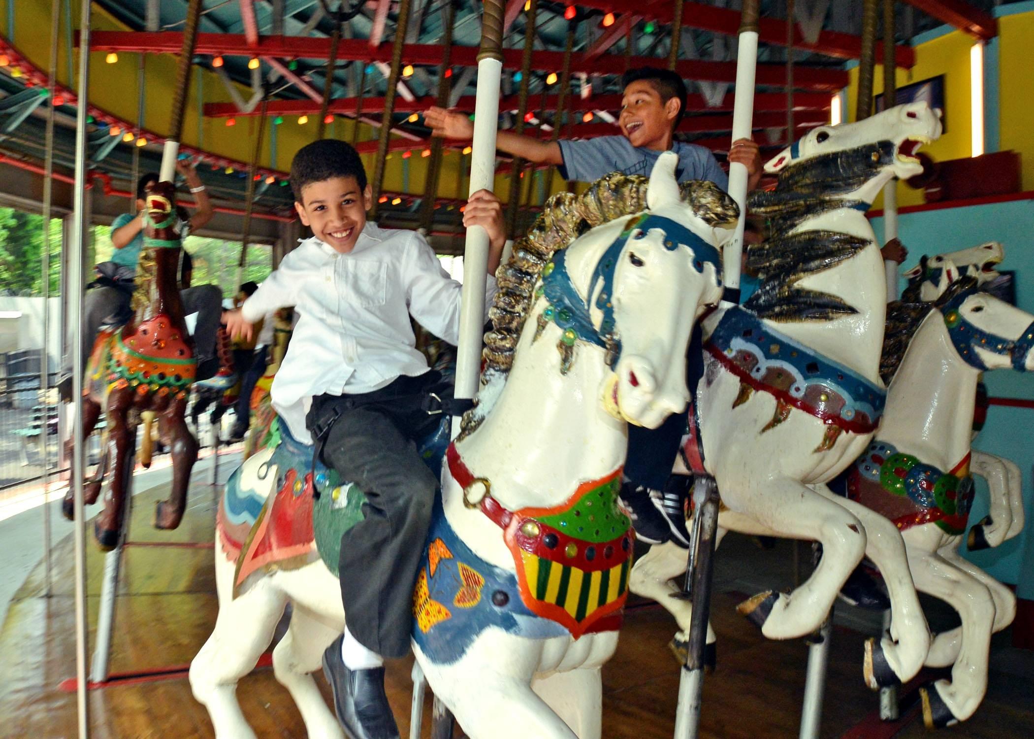 Children ride a carousel that dates to the early 1900s. It was brought to Queens from Coney Island, Brooklyn, for the 1964 World's Fair. Today the carousel is located near the Queens Zoo, one of a number of attractions that can be seen as Queens marks the 50th anniversary of the fair.