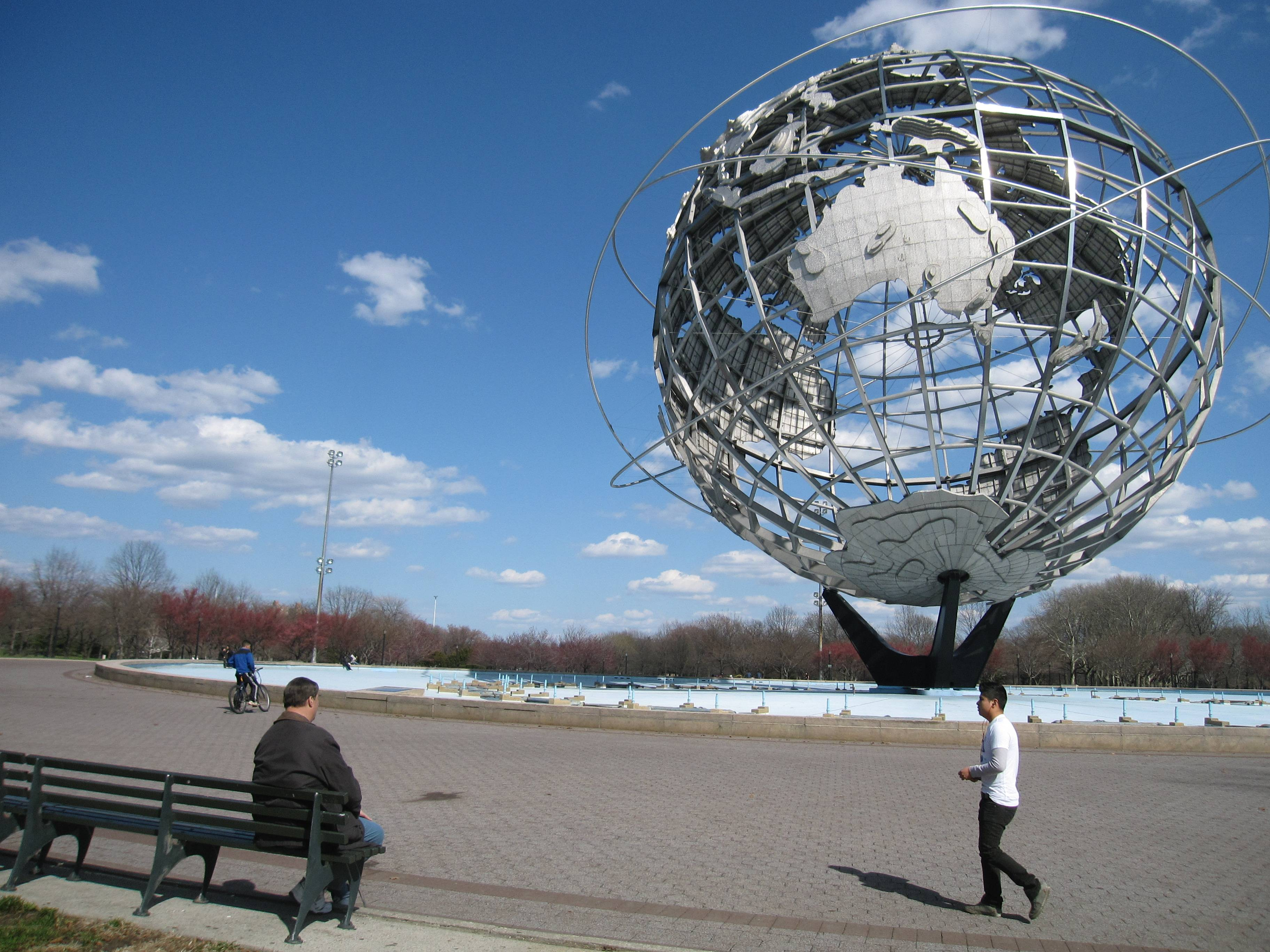 A man walks near the Unisphere, a 12-story steel globe that debuted 50 years ago at the 1964 World's Fair in the Queens borough of New York.
