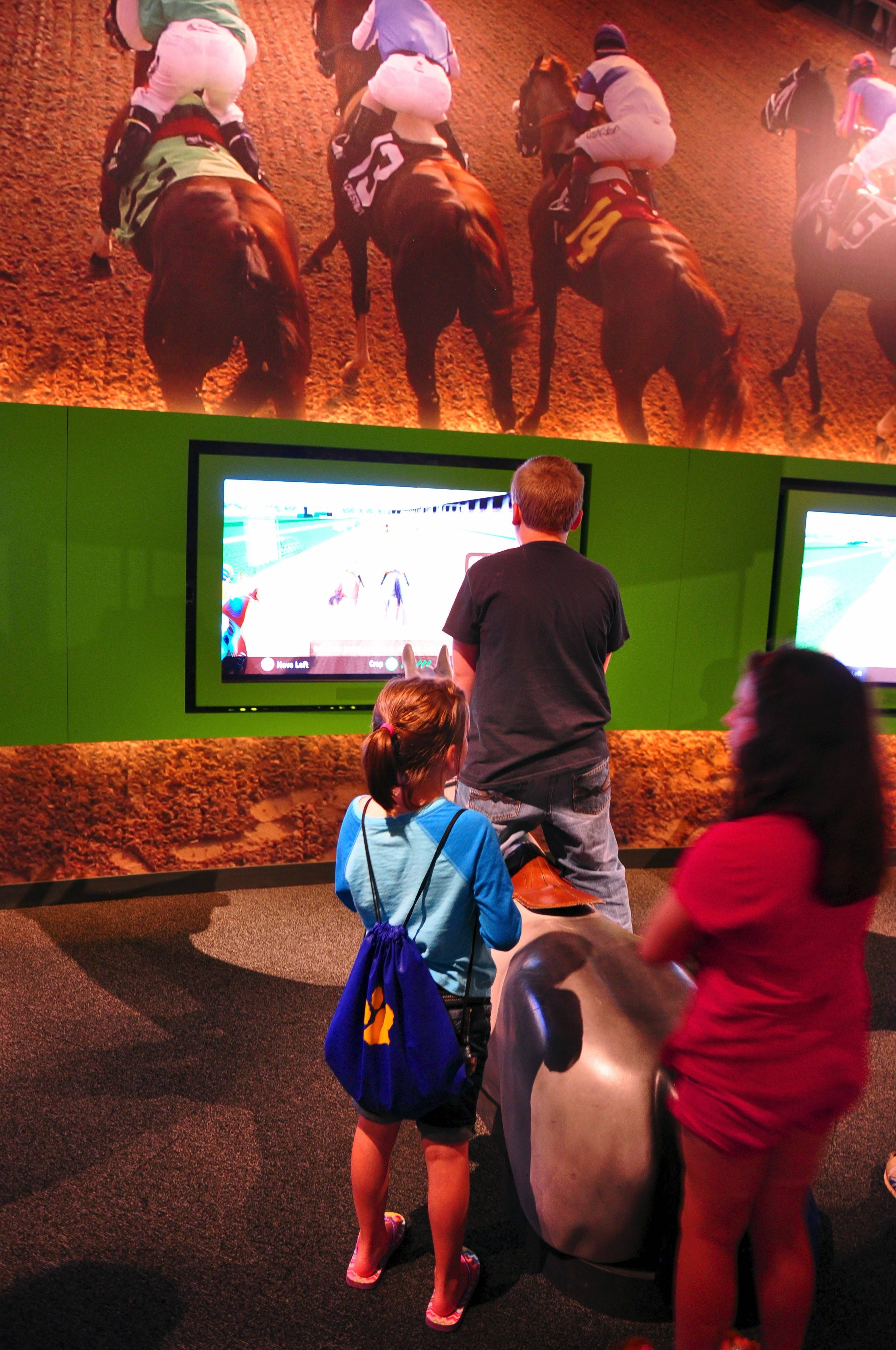 The Kentucky Derby Museum at Churchill Downs has two floors of exhibits about the Derby and horse racing, including a chance to mount a simulated horse and race on the track via video screen.