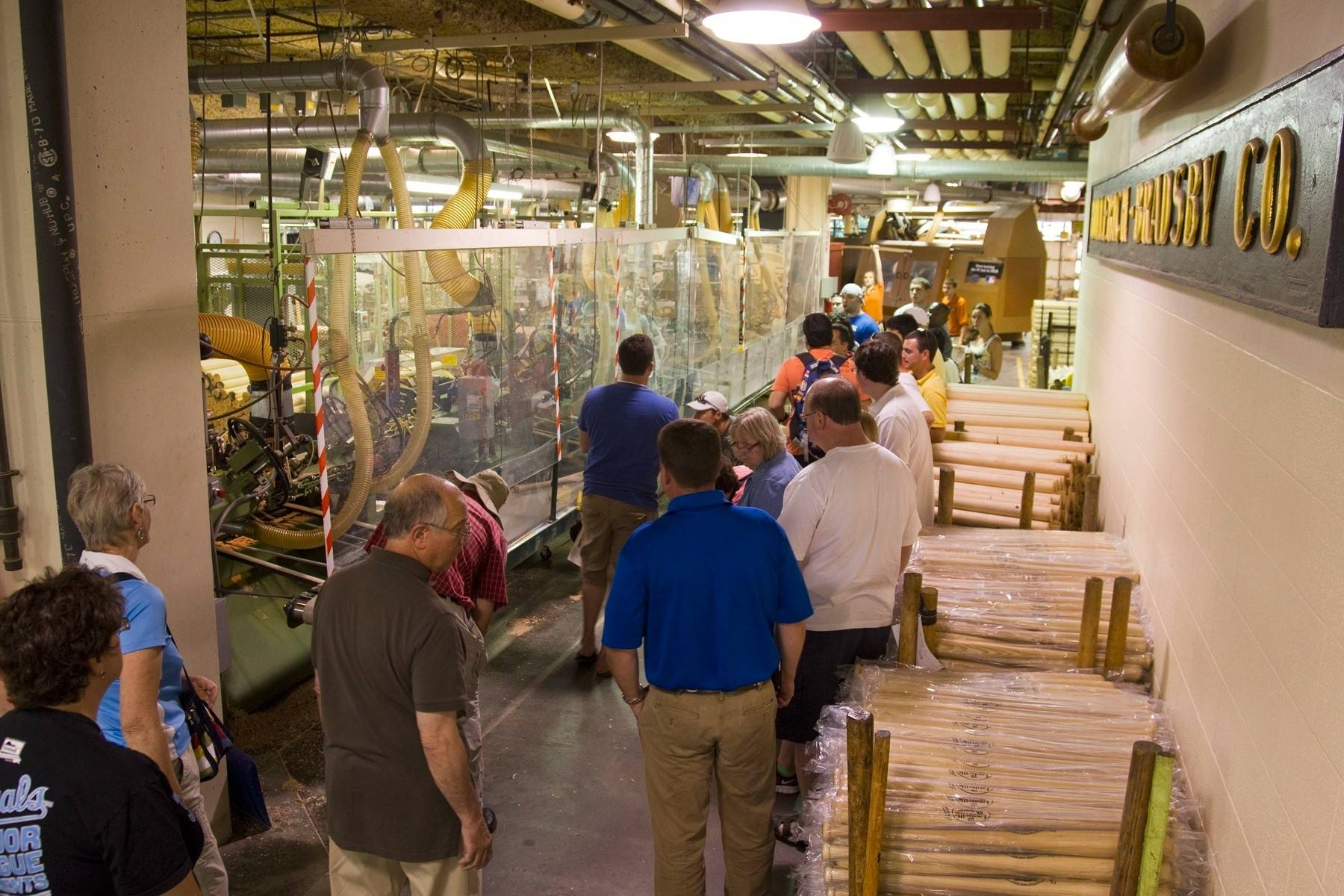 Visitors watch Louisville Slugger bats being made on factory tours.