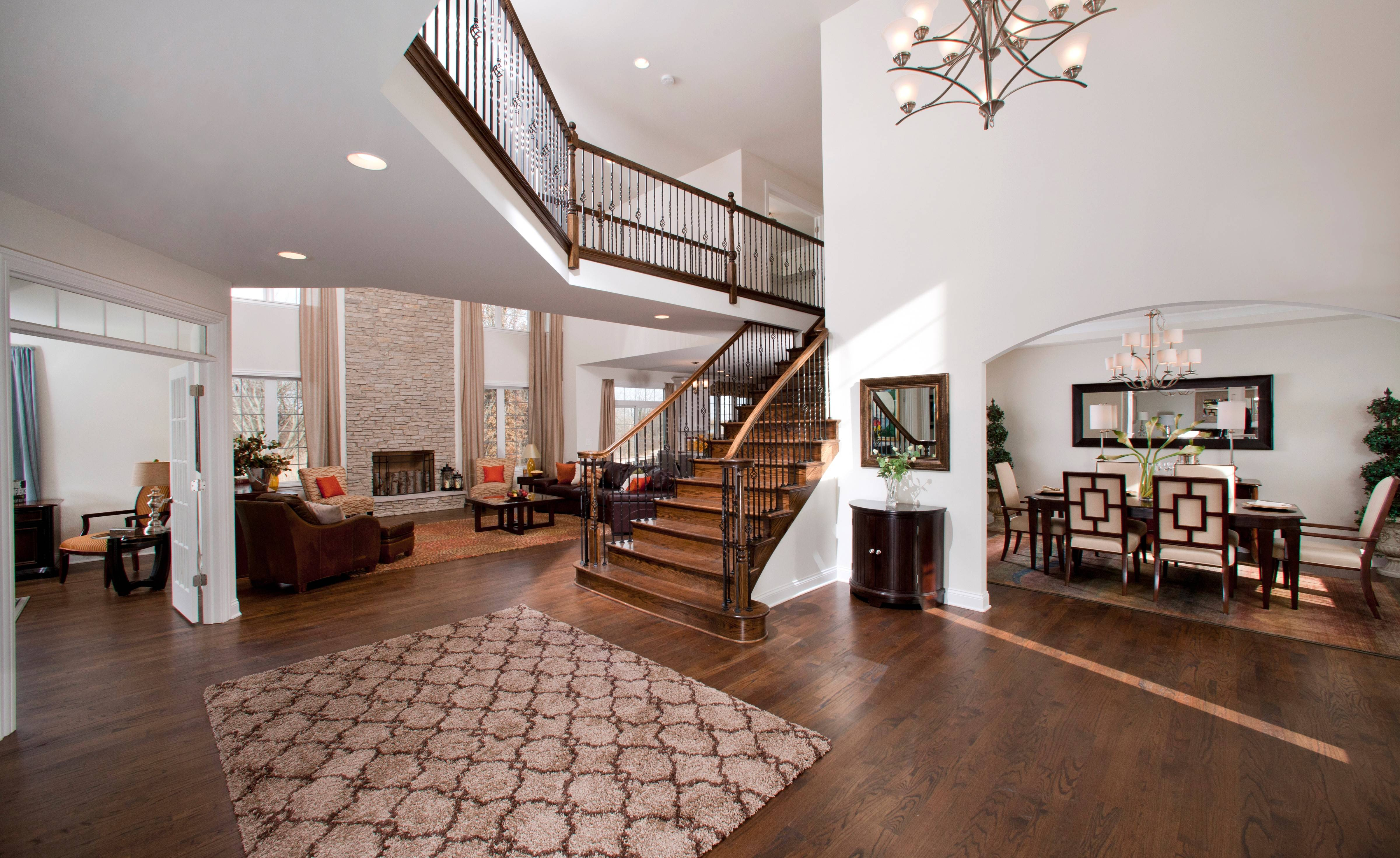A grand staircase and open layout has a great impact on guests when they enter a new home.