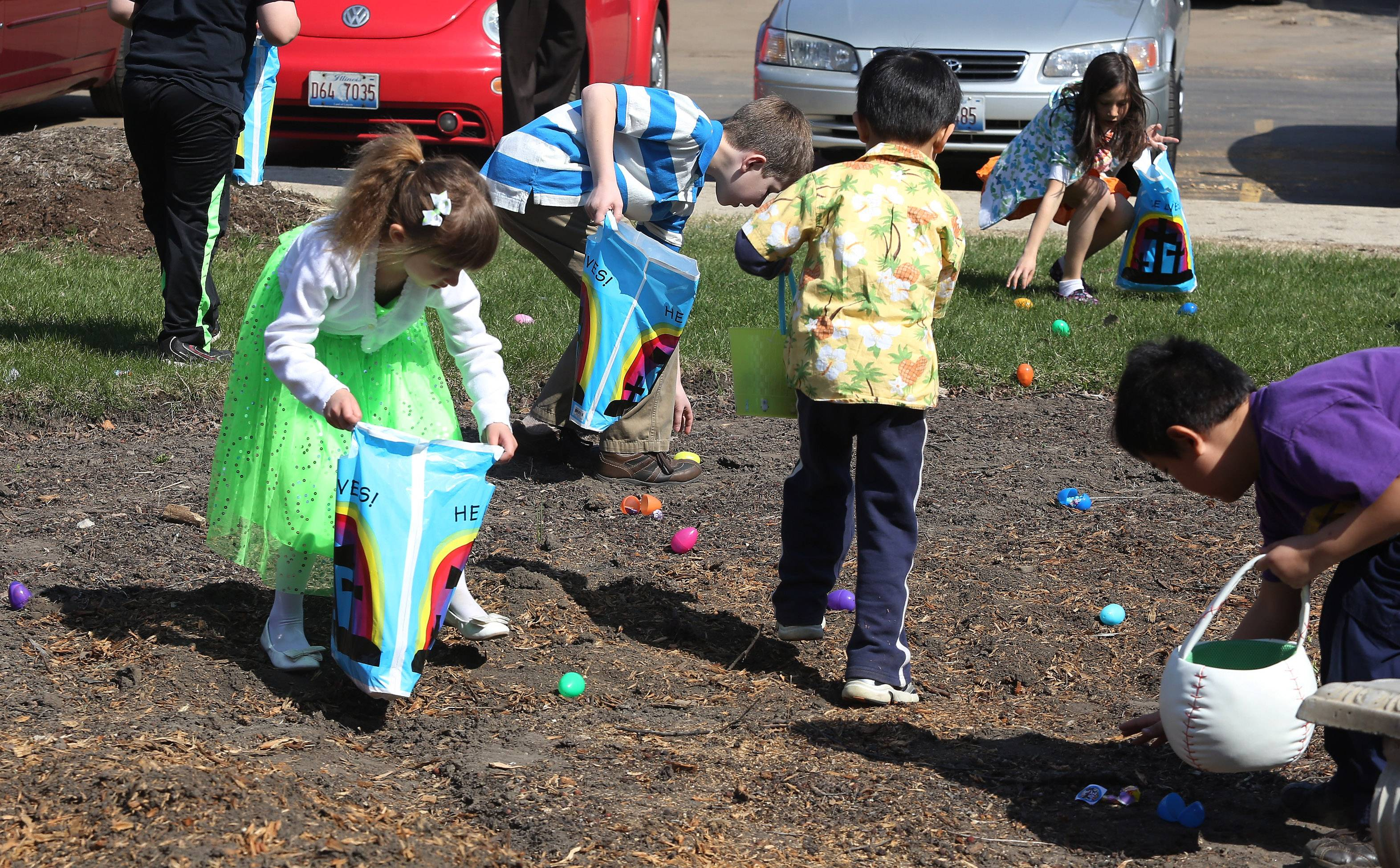 Children rushed around looking for plastic eggs during the Faith Lutheran Church Eggstravaganza event Easter Sunday in Arlington Heights. About 30 children searched for 850 eggs, worked on religious crafts, and listened to the story of Easter.