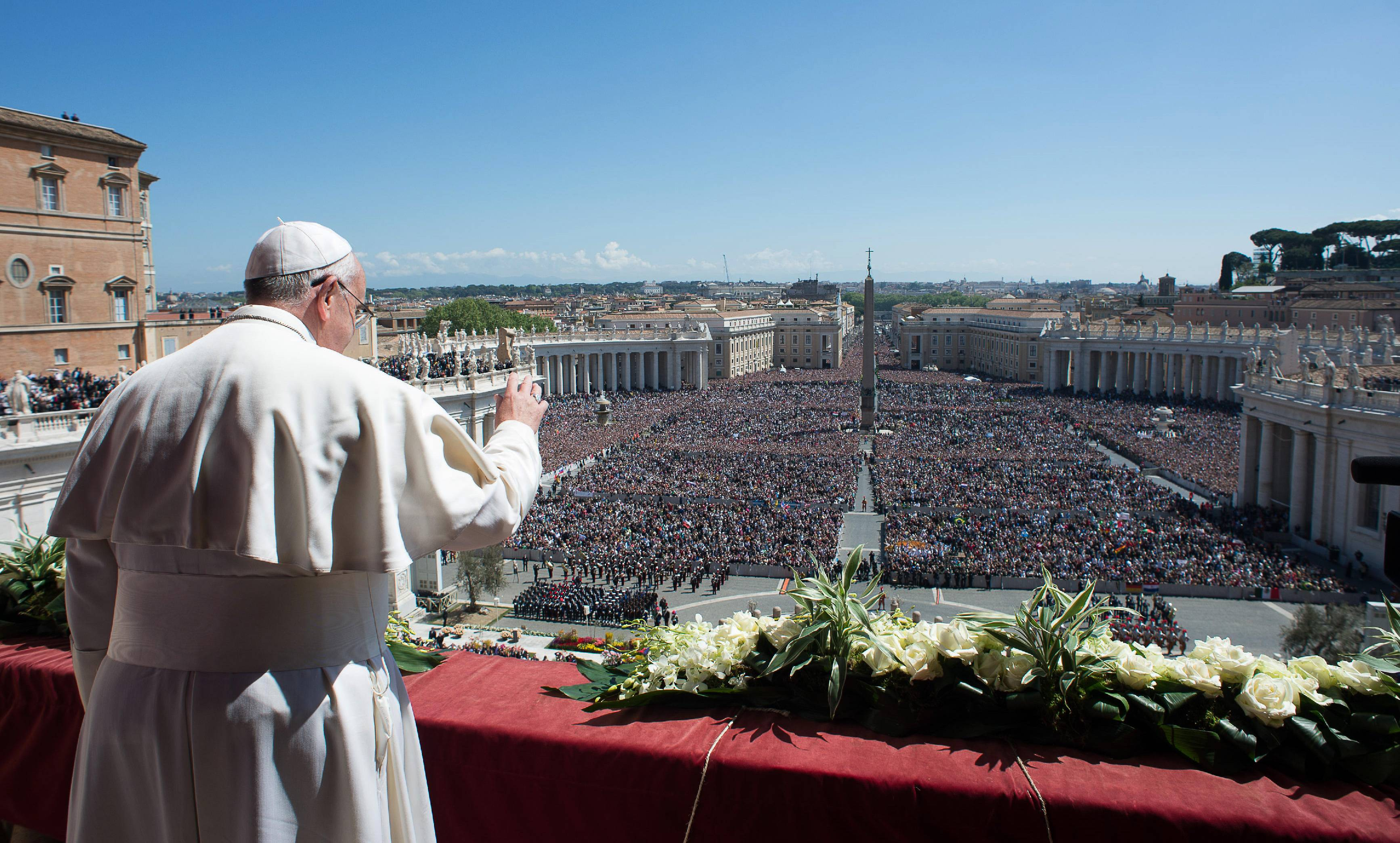 Pope Francis waves to the crowd from the balcony of St. Peter's Basilica where he delivered the Urbi et Orbi at the end of the Easter Mass in St. Peter's Square at the the Vatican Sunday.