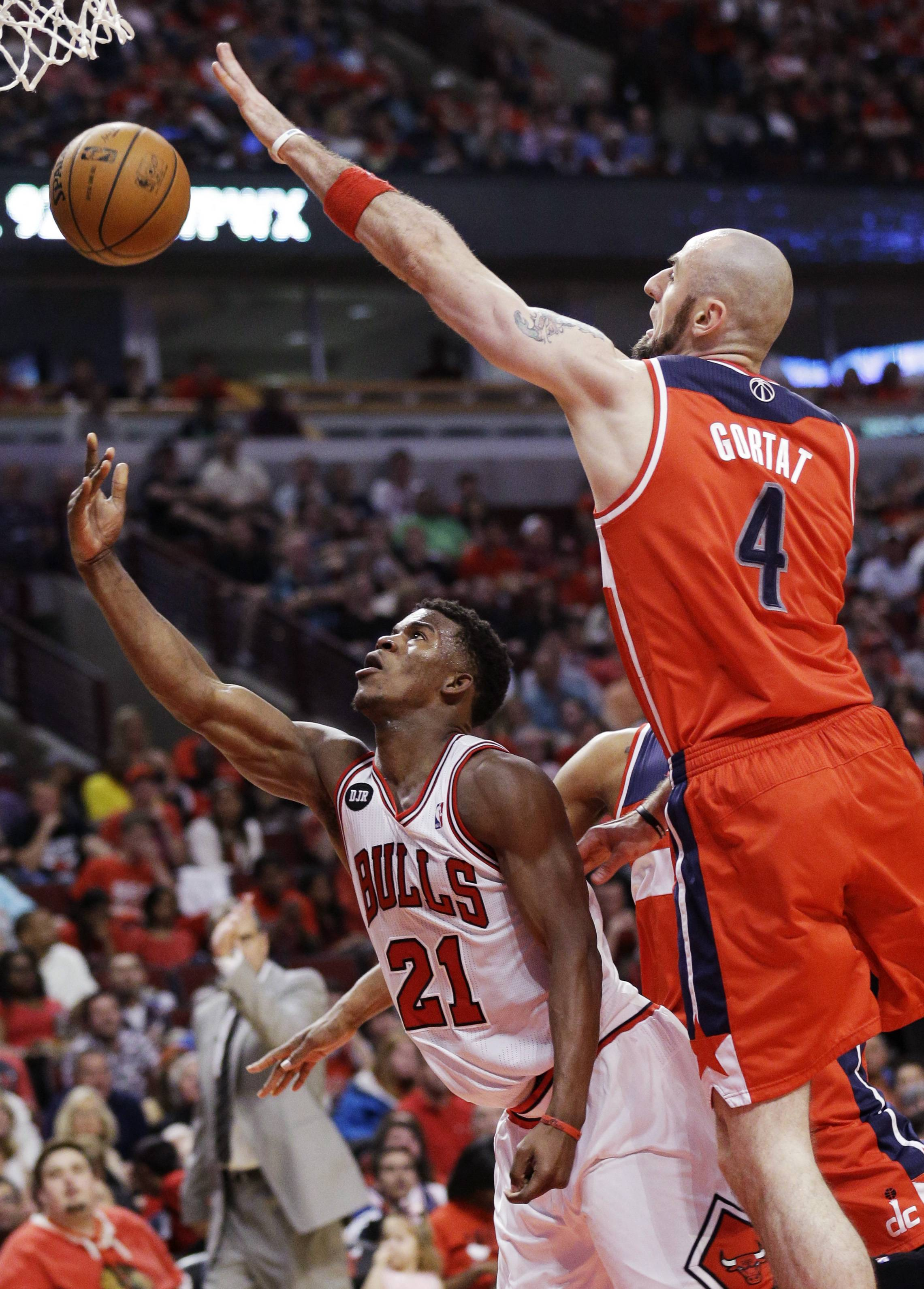Bulls guard Jimmy Butler shoots against Wizards center Marcin Gortat during the second half in Game 1 of an opening-round playoff series at the United Center.