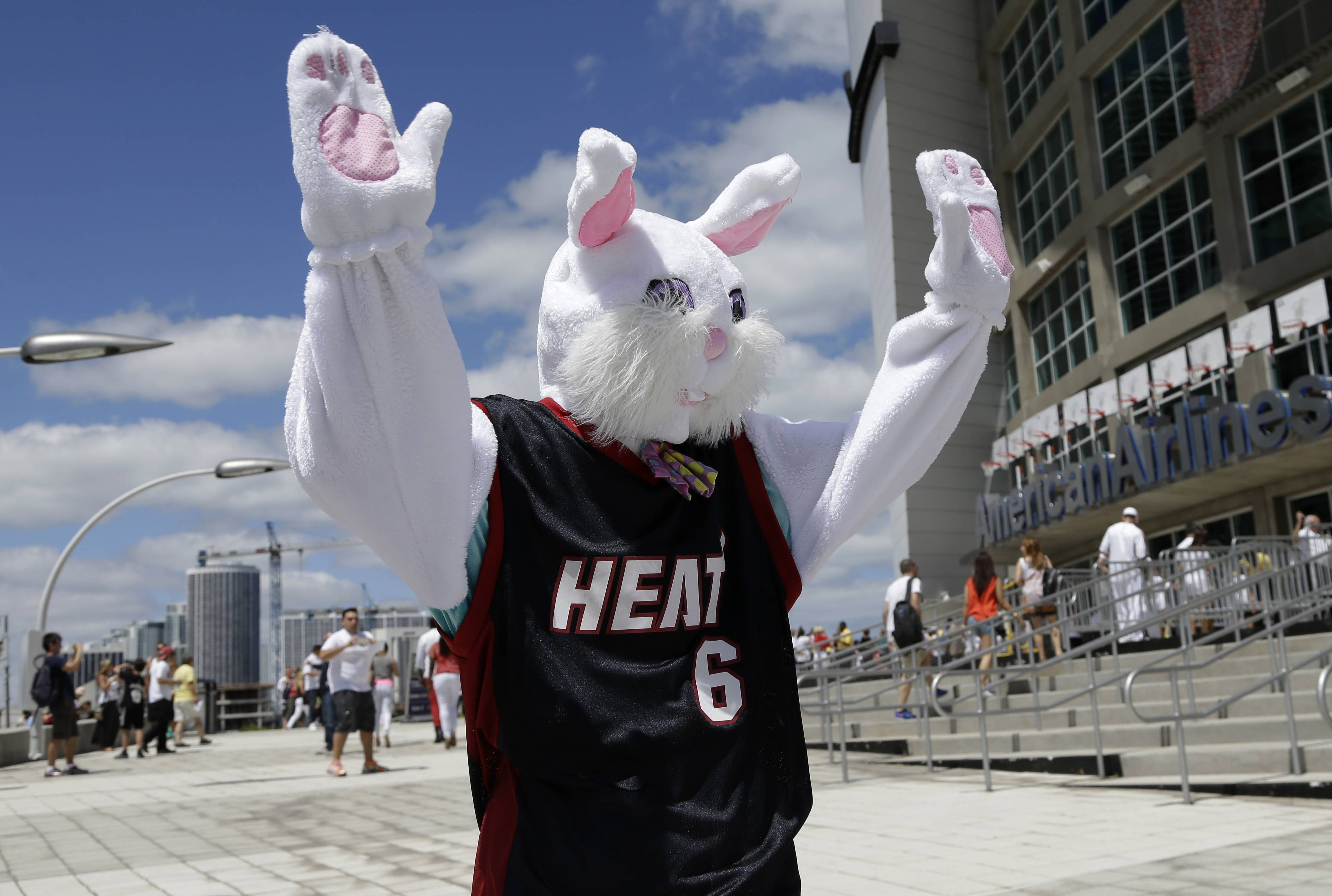 A person dressed as the Easter Bunny wears a LeBron James jersey and waves to fans as they arrive for Game 1 of an opening-round NBA basketball playoff series between the Miami Heat and the Charlotte Bobcats, Sunday, April 20, 2014, in Miami.