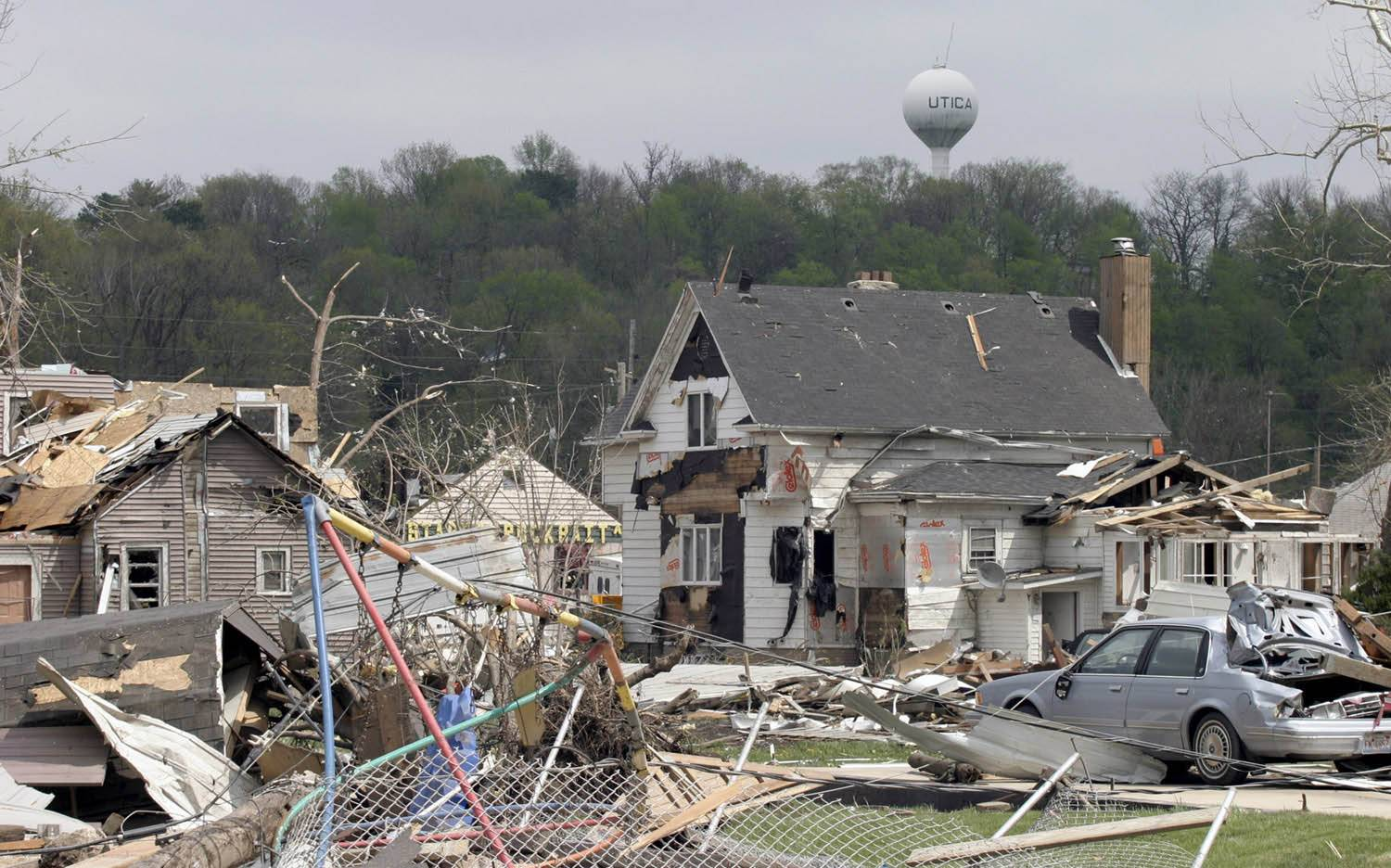 The devastation in Utica the day after the April 20, 2004, tornado. Eight people were found dead in the wreckage throughout town..