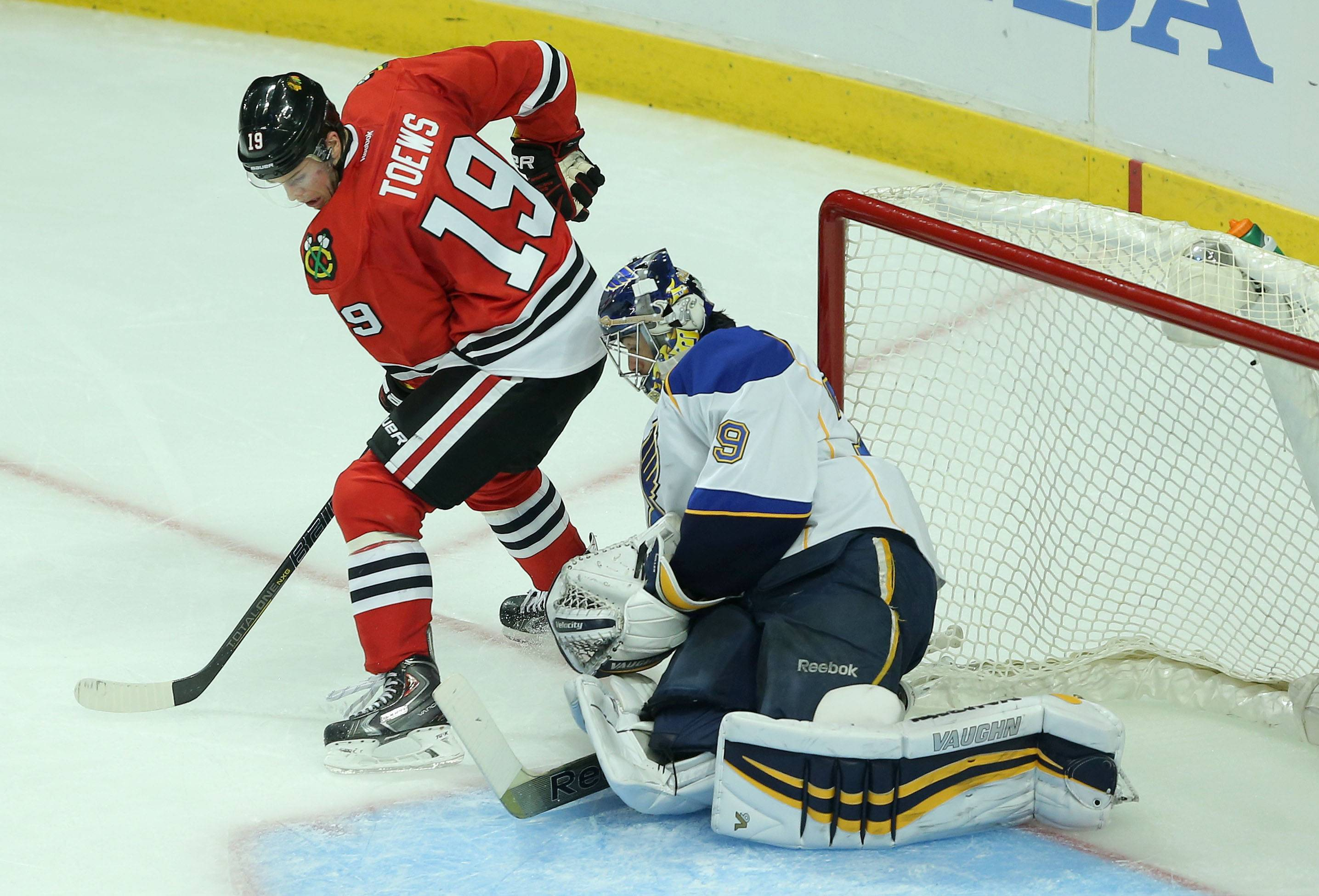 Blackhawks center Jonathan Toews pressures St. Louis Blues goalie Ryan Miller during game 3 of the NHL first-round Stanley Cup playoffs in Chicago Monday night.