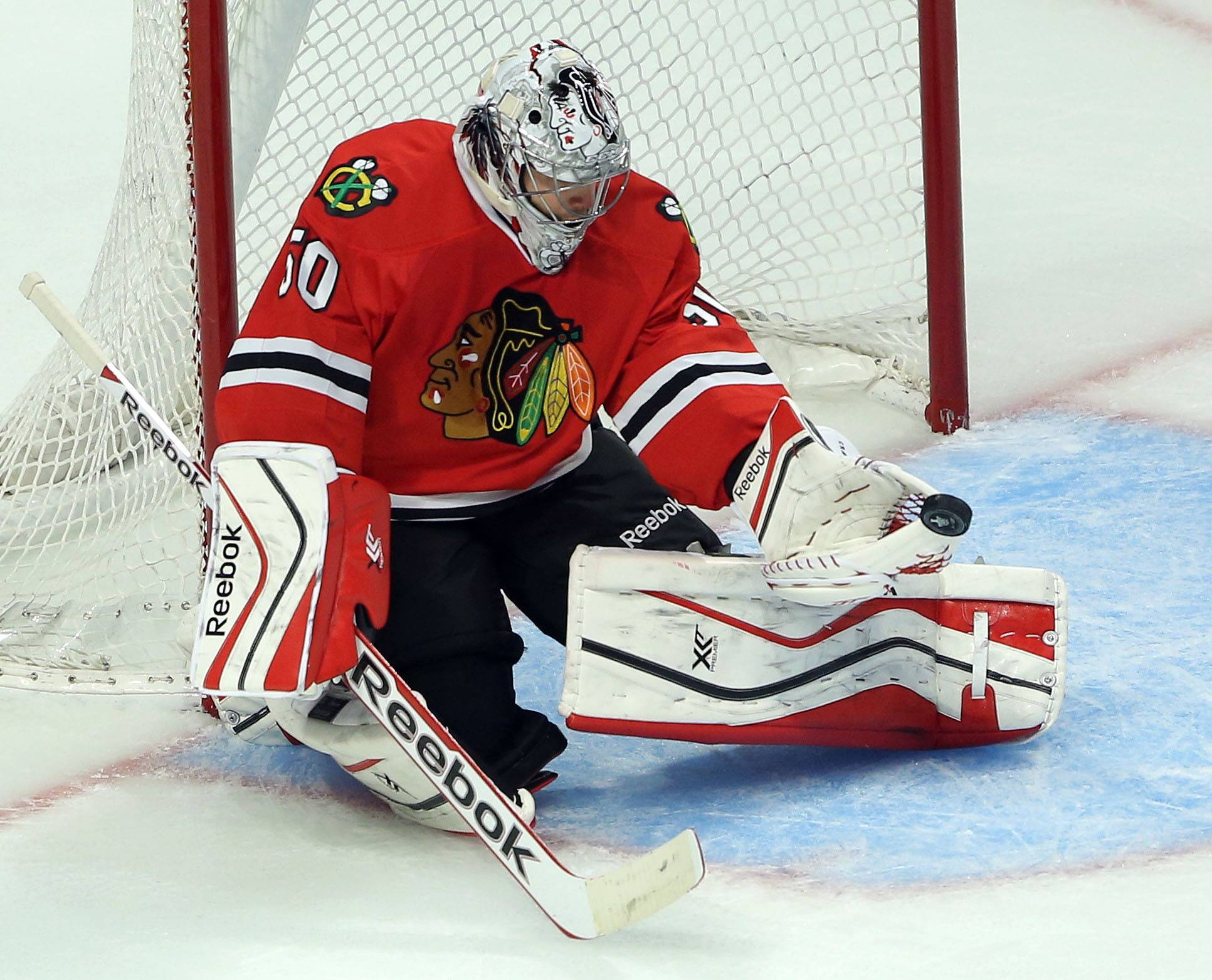 Blackhawks goalie Corey Crawford makes a save during game 3 of the NHL first-round Stanley Cup playoffs Monday night in Chicago. He made 34 saves in the victory.