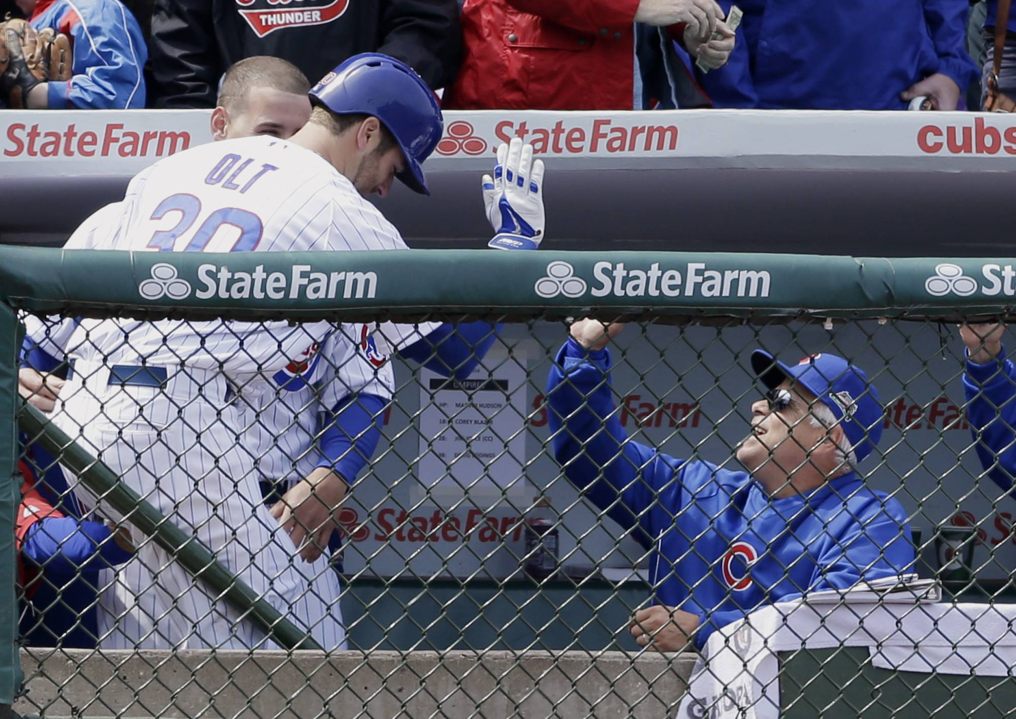 The Cubs' Mike Olt, left, celebrates with manager Rick Renteria, right, in Saturday's game against the Reds. Although Renteria has exuded eternal optimism — a needed trait for anybody involved with the Cubs — he has exhibited a couple of flash points.
