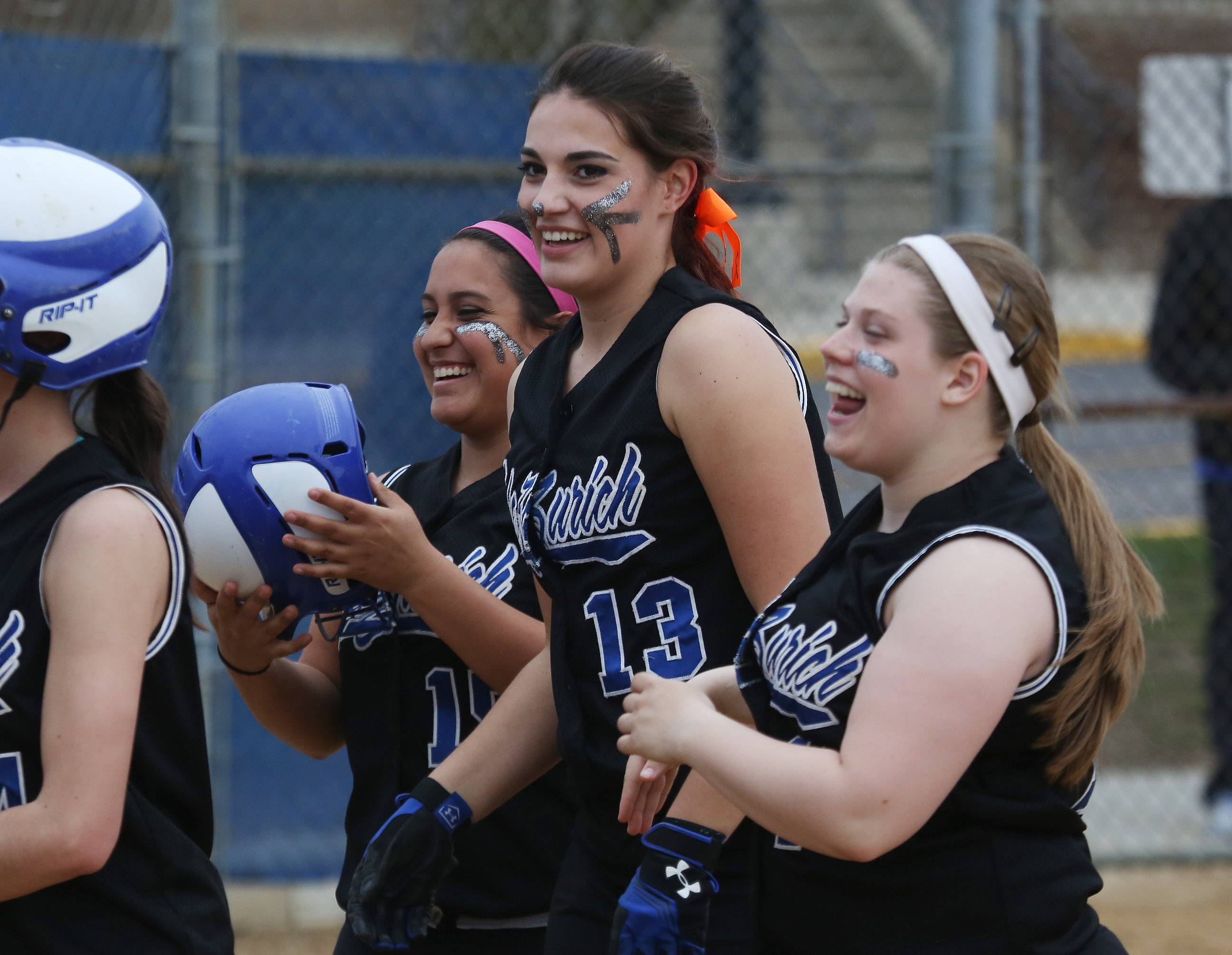 Lake Zurich hitter Mallory Parsons (13) celebrates with teammates after a hitting grand slam in the first inning against visiting Warren.