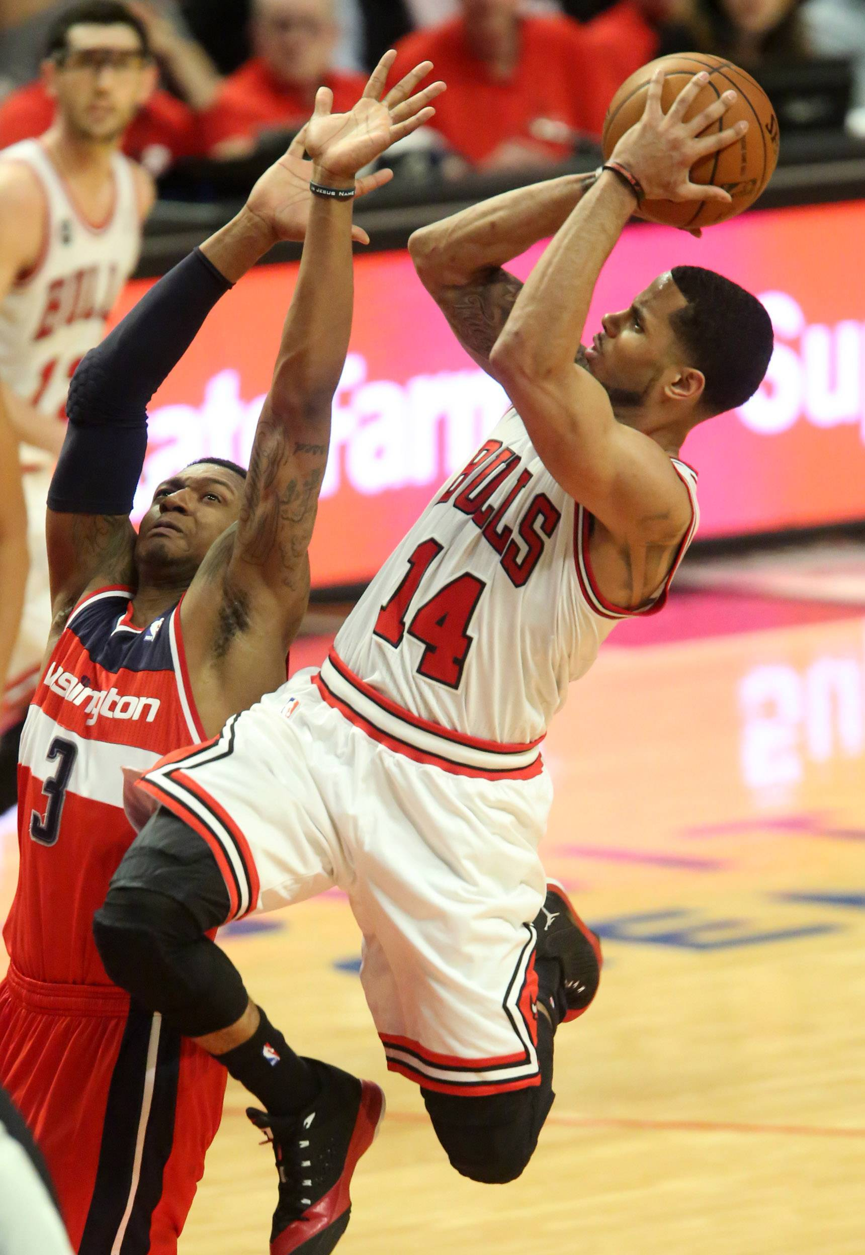 D.J. Augustin shoots against Bradley Beal during the Bulls' Game 1 loss to Washington on Sunday. Augustin was just 3 of 15 from the field.