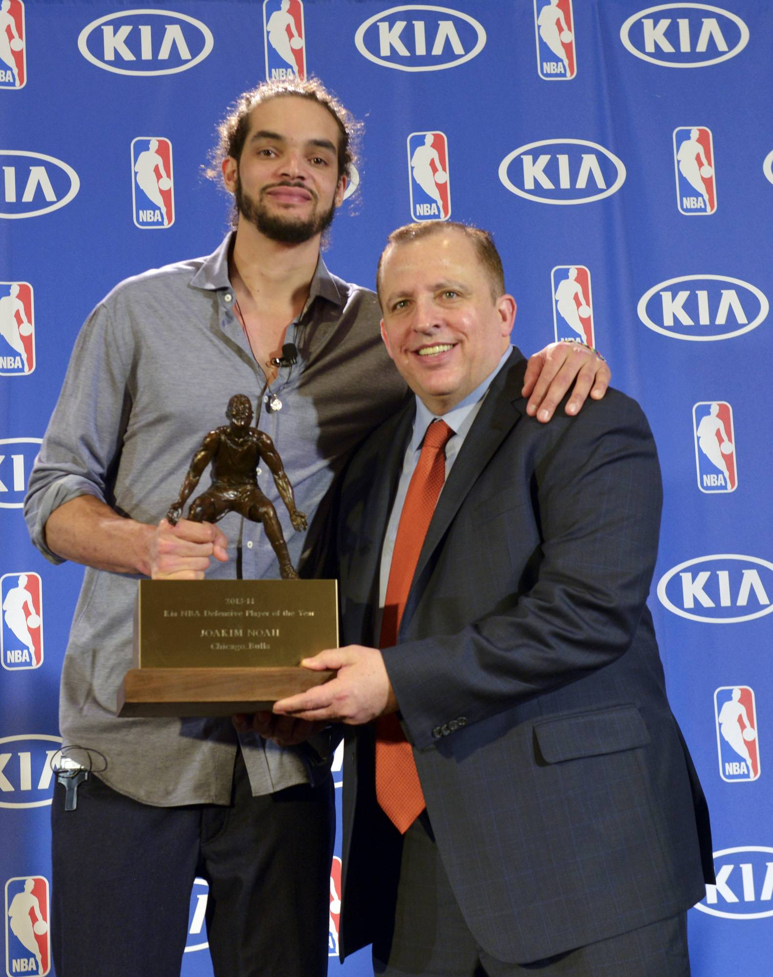 Bulls center Joakim Noah, left, and coach Tom Thibodeau pose for a photo after Noah was awarded the NBA's Defensive Player of the Year, Monday, April 21, 2014.
