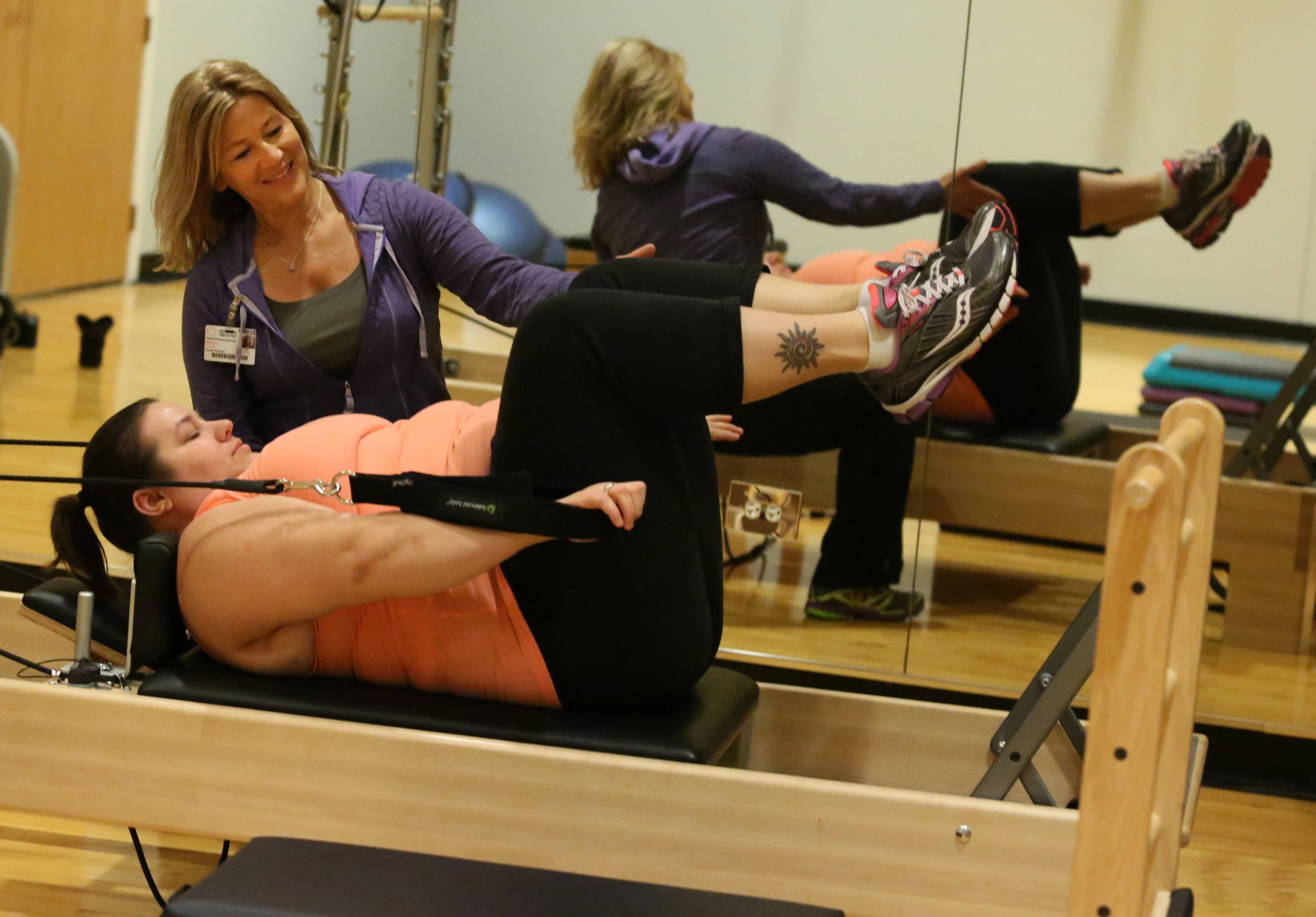 Fittest Loser Allie Monroe works out on the Pilates reformer machine at Prairie Stone Fitness Center in Hoffman Estates where her mom, Glenna Gineris, is a fitness manager.