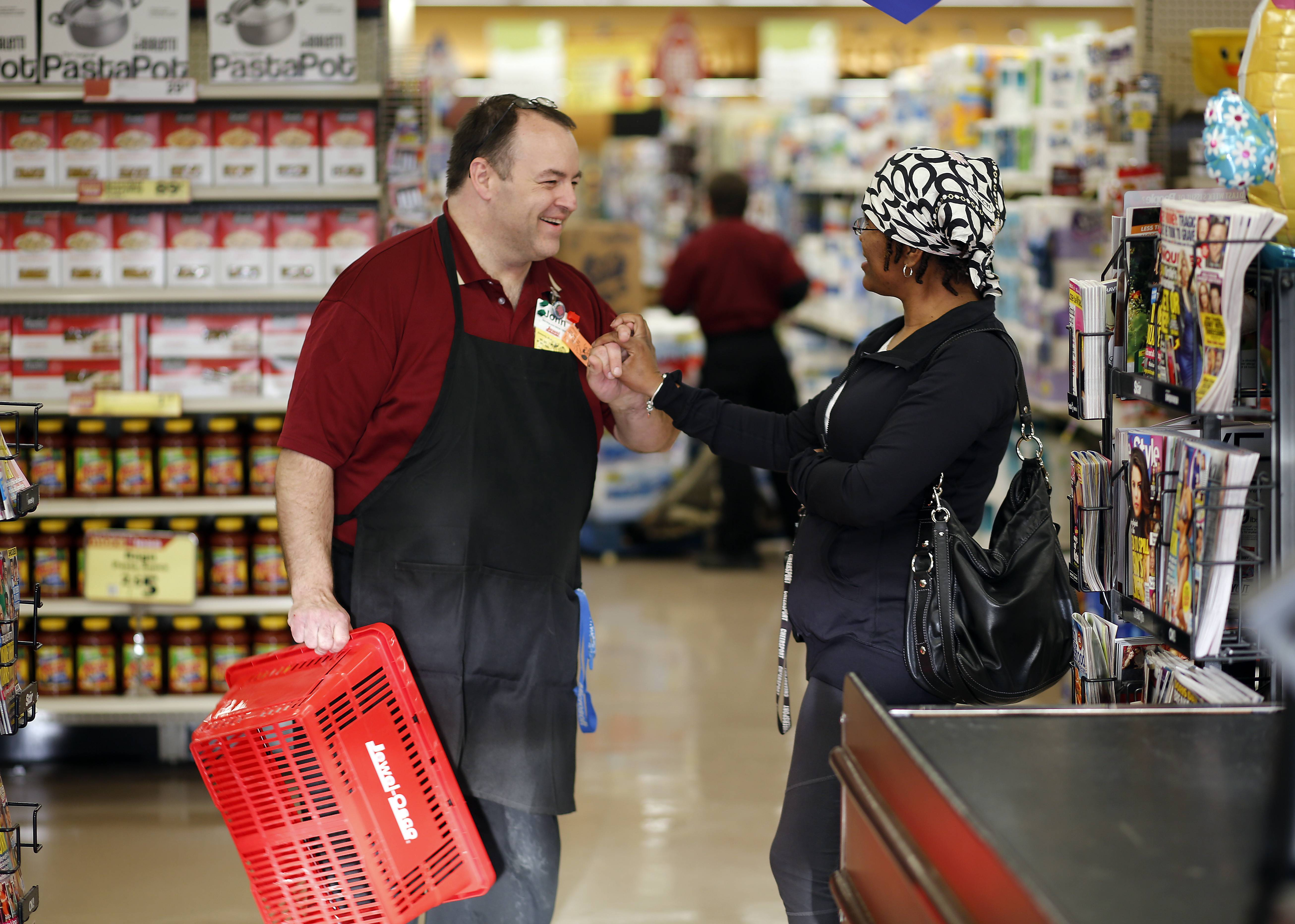 John Bohanek catches up with customer Patrice Dirl of St. Charles while working at Jewel in South Elgin.