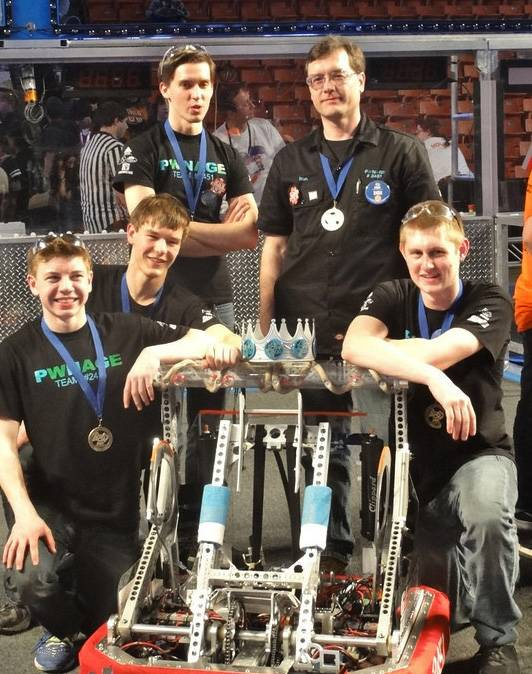 FIRST Robotics PWNAGE Midwest Regional Drive Team members, from left, are Ryder Stout of St. Charles East High School, David Mahler of Batavia High School, Ryan Newendyke of West Aurora High School, mentor Ron Faulkner, and Thomas Kein of Batavia High School.