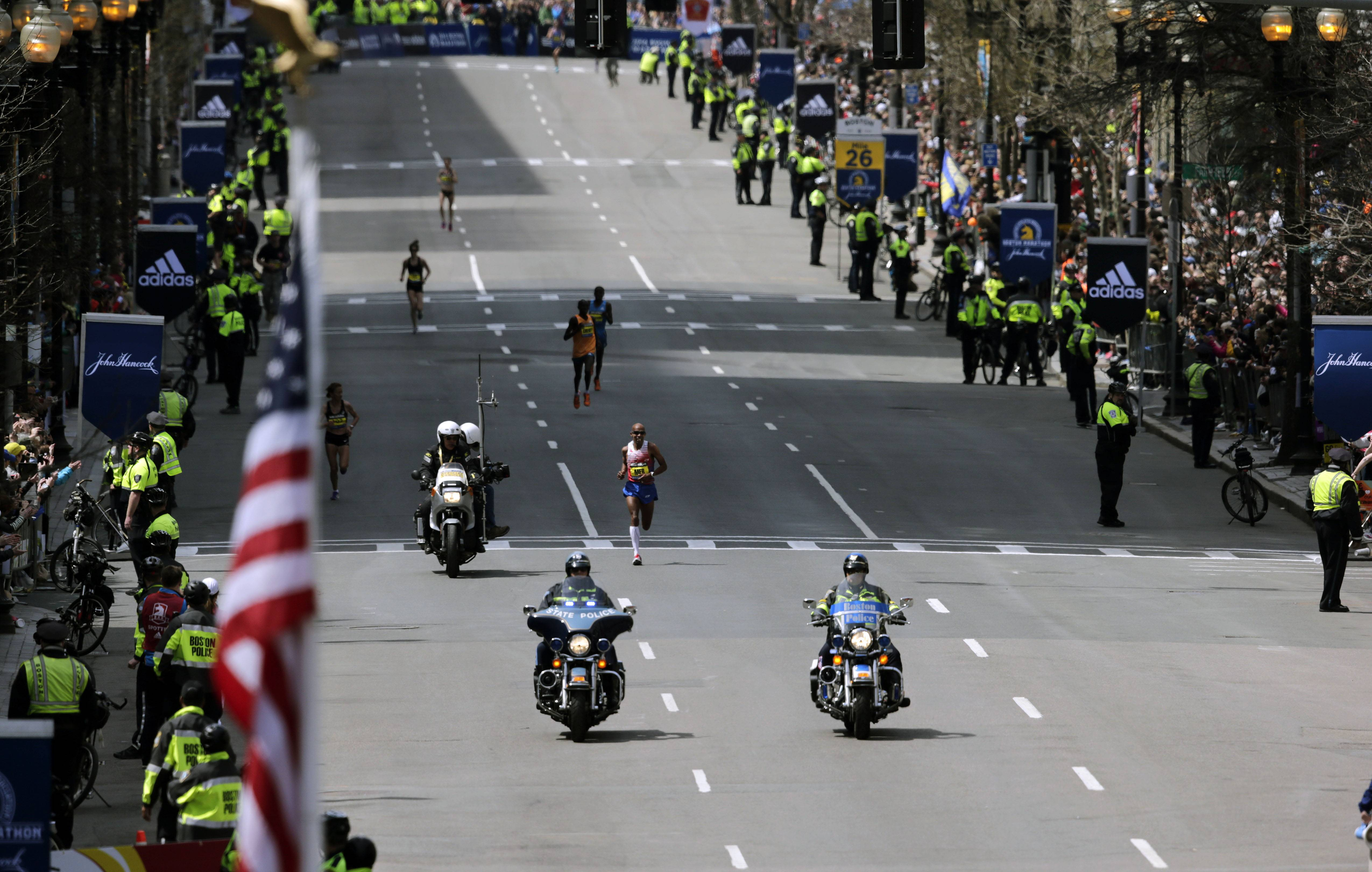 Meb Keflezighi, of San Diego, Calif., heads toward the finish line to win the 118th Boston Marathon Monday, April 21, 2014 in Boston.