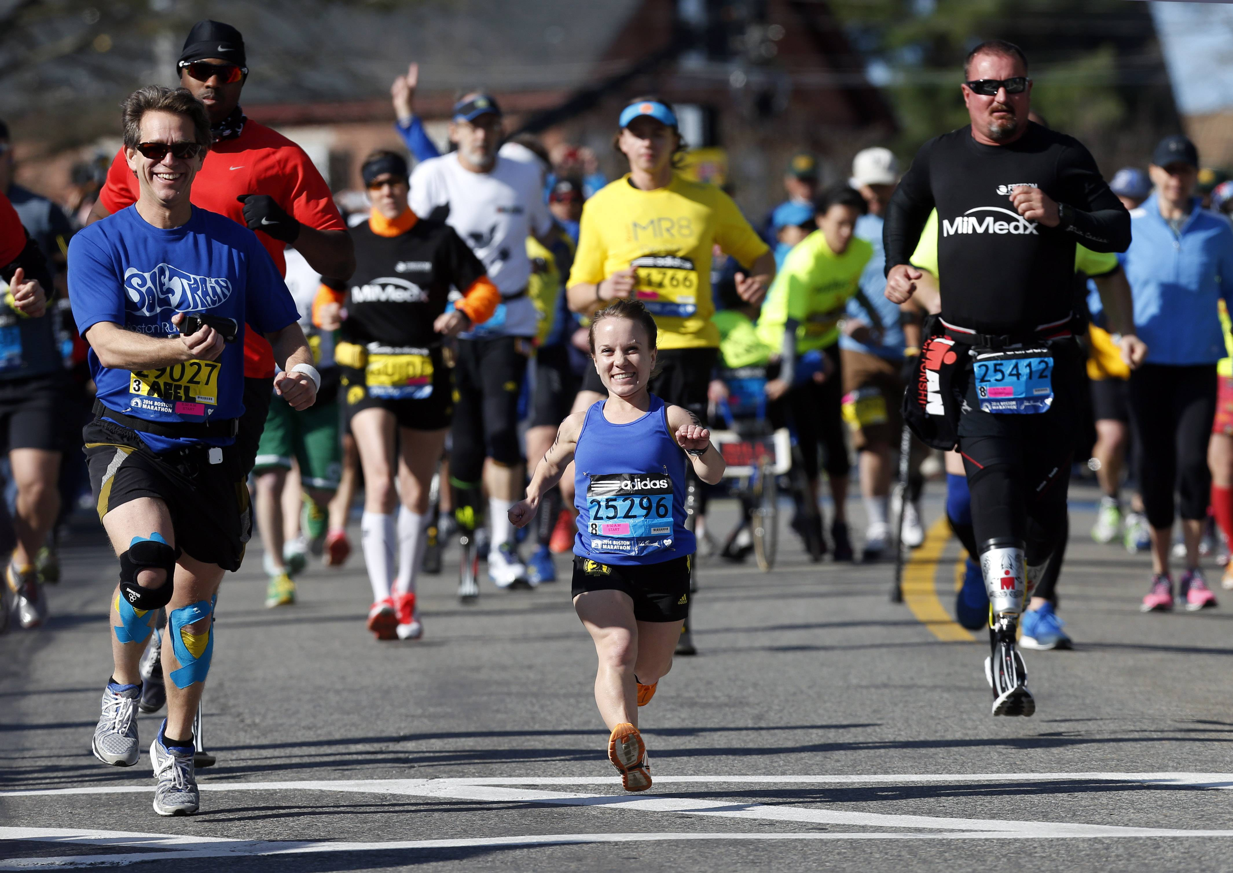 Mobility-impared runners David Abel, left, Juli Windsor, and Scott Rigsby compete in the 118th Boston Marathon Monday, April 21, 2014 in Hopkinton, Mass.