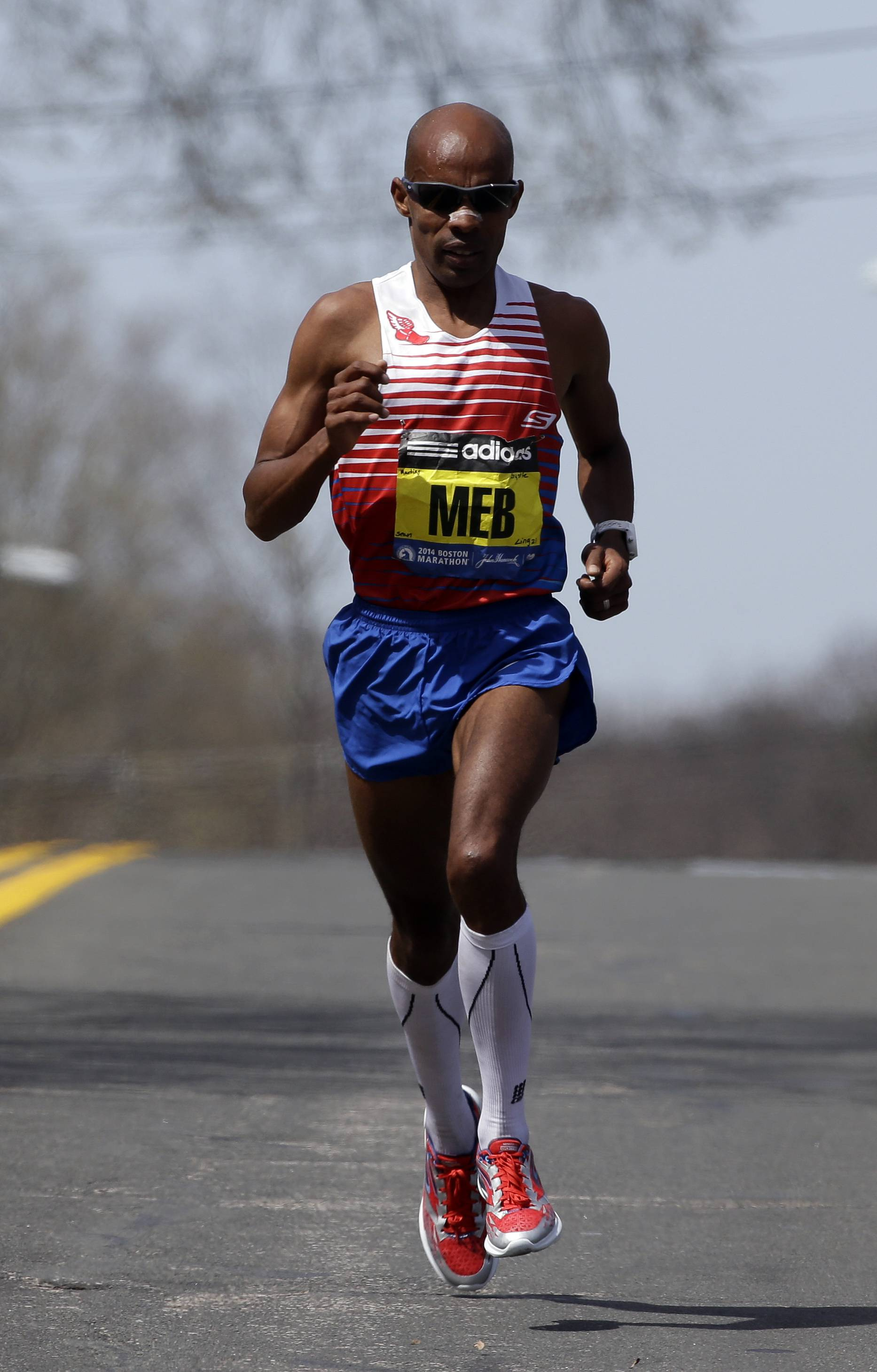 Meb Keflezighi runs alone on the race course during the 118th Boston Marathon Monday, April 21, 2014, en route to Boston.