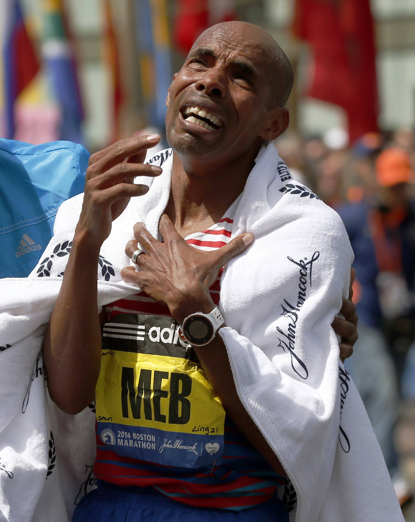 Meb Keflezighi, of San Diego, Calif., becomes emotional after winning the 118th Boston Marathon, Monday, April 21, 2014, in Boston.