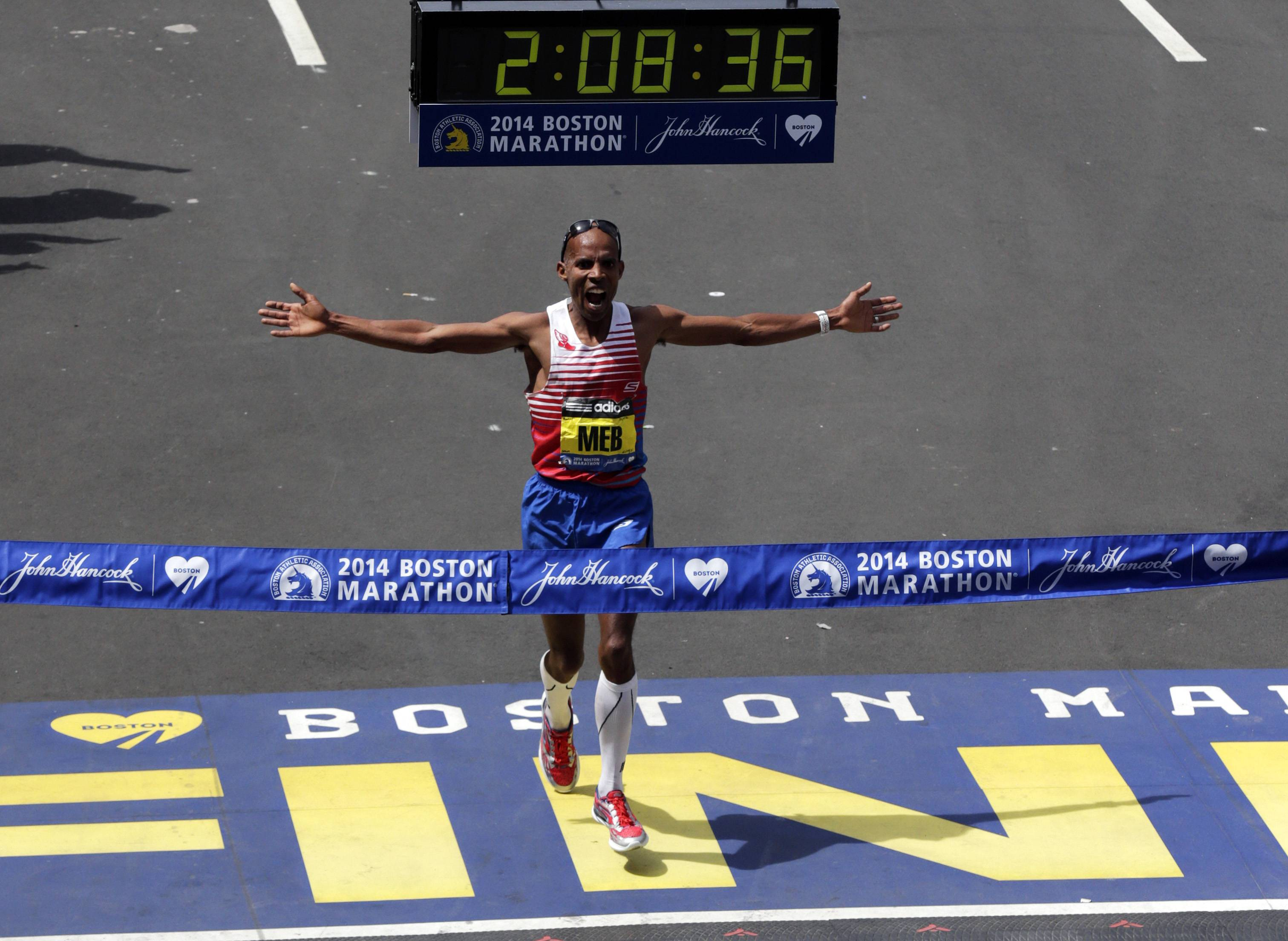 Meb Keflezighi, of San Diego, Calif., celebrates as he crosses the finish line to win the 118th Boston Marathon
