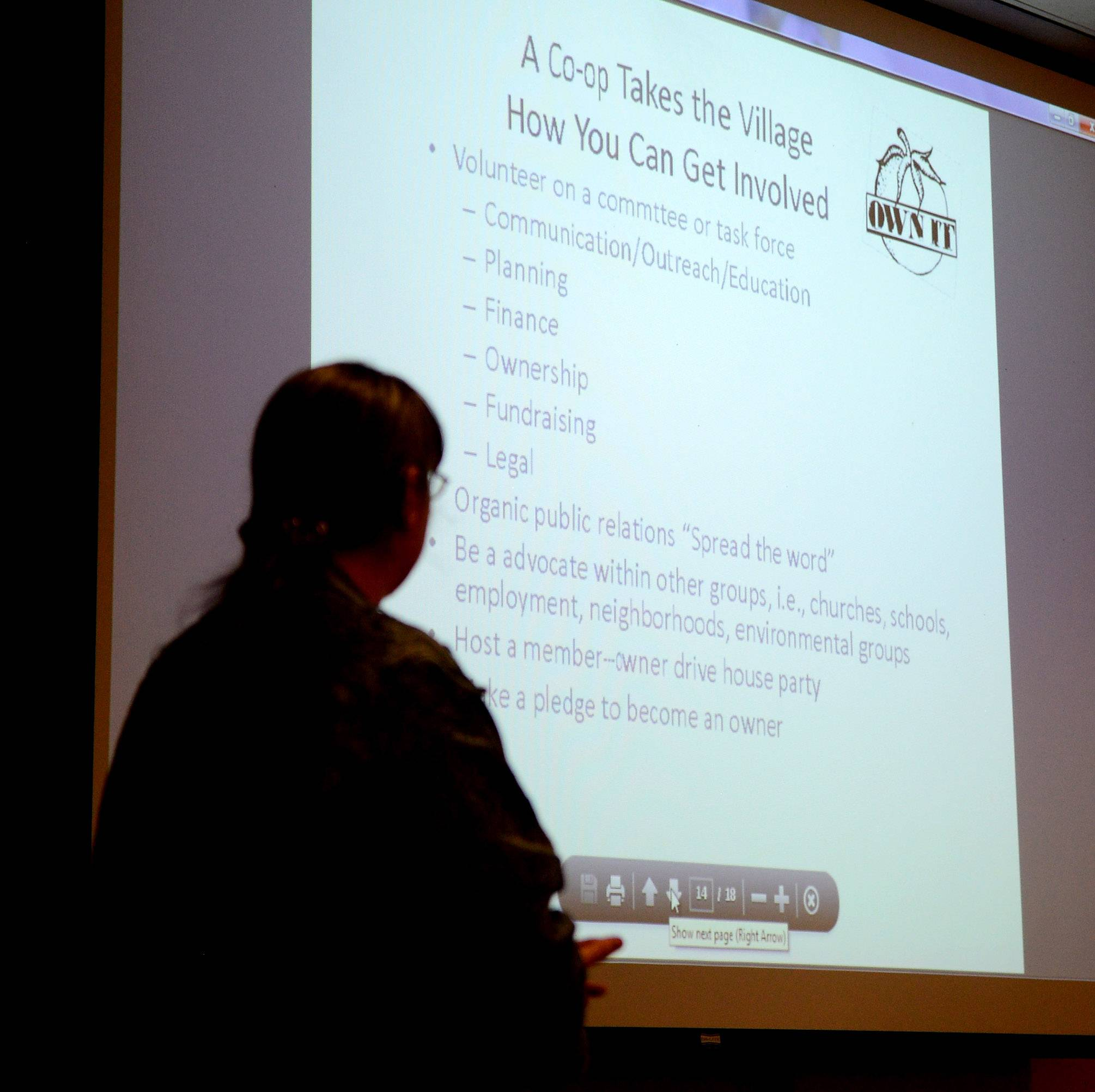 Kelley Mathews shows a PowerPoint presentation during an informational meeting for the Green Tomato Grocery. The food cooperative hopes to open in Batavia by 2016.