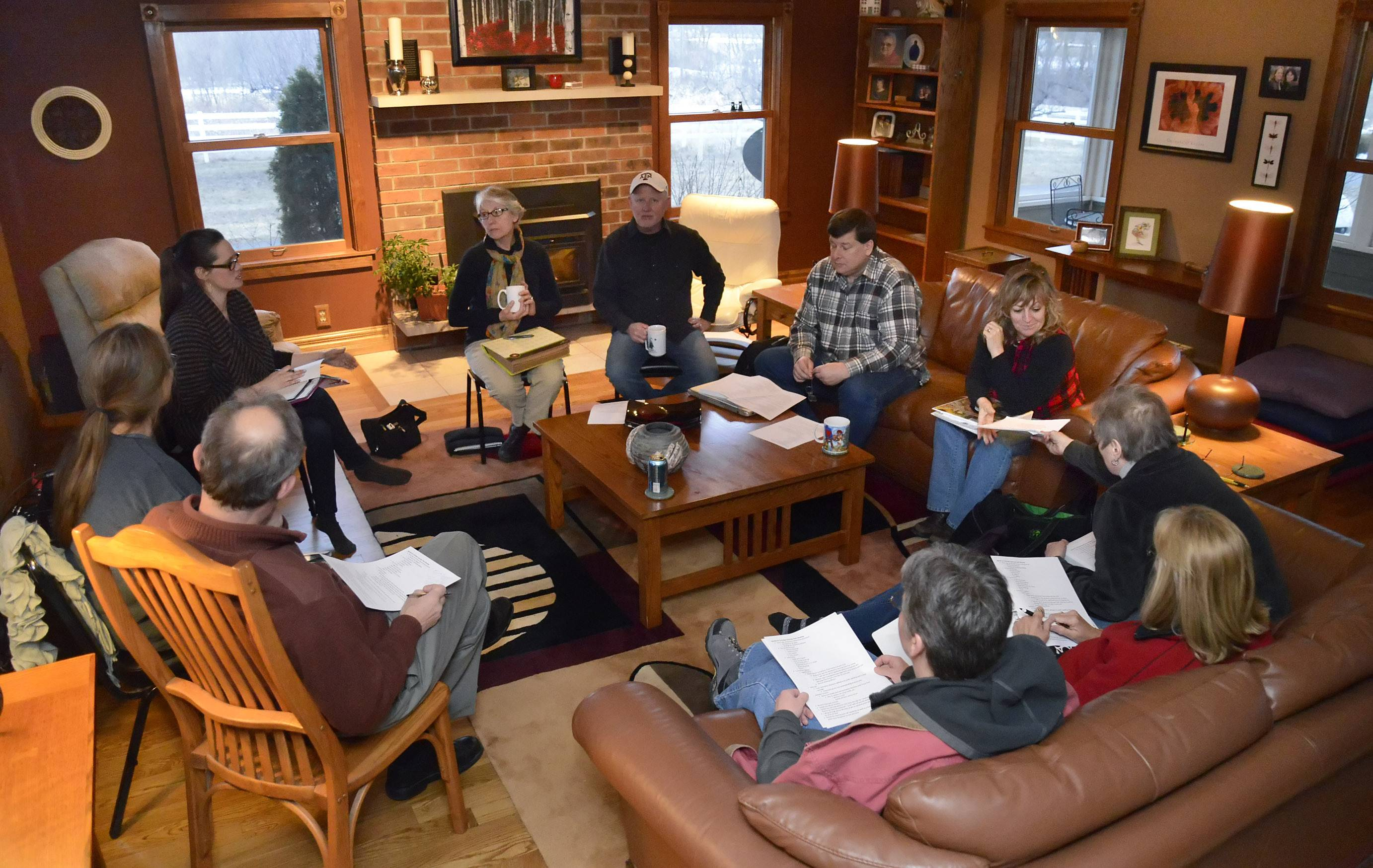 Members of the a yet-to-be-named McHenry area food co-op meet at Scott and Kim Brix's home in Marengo.