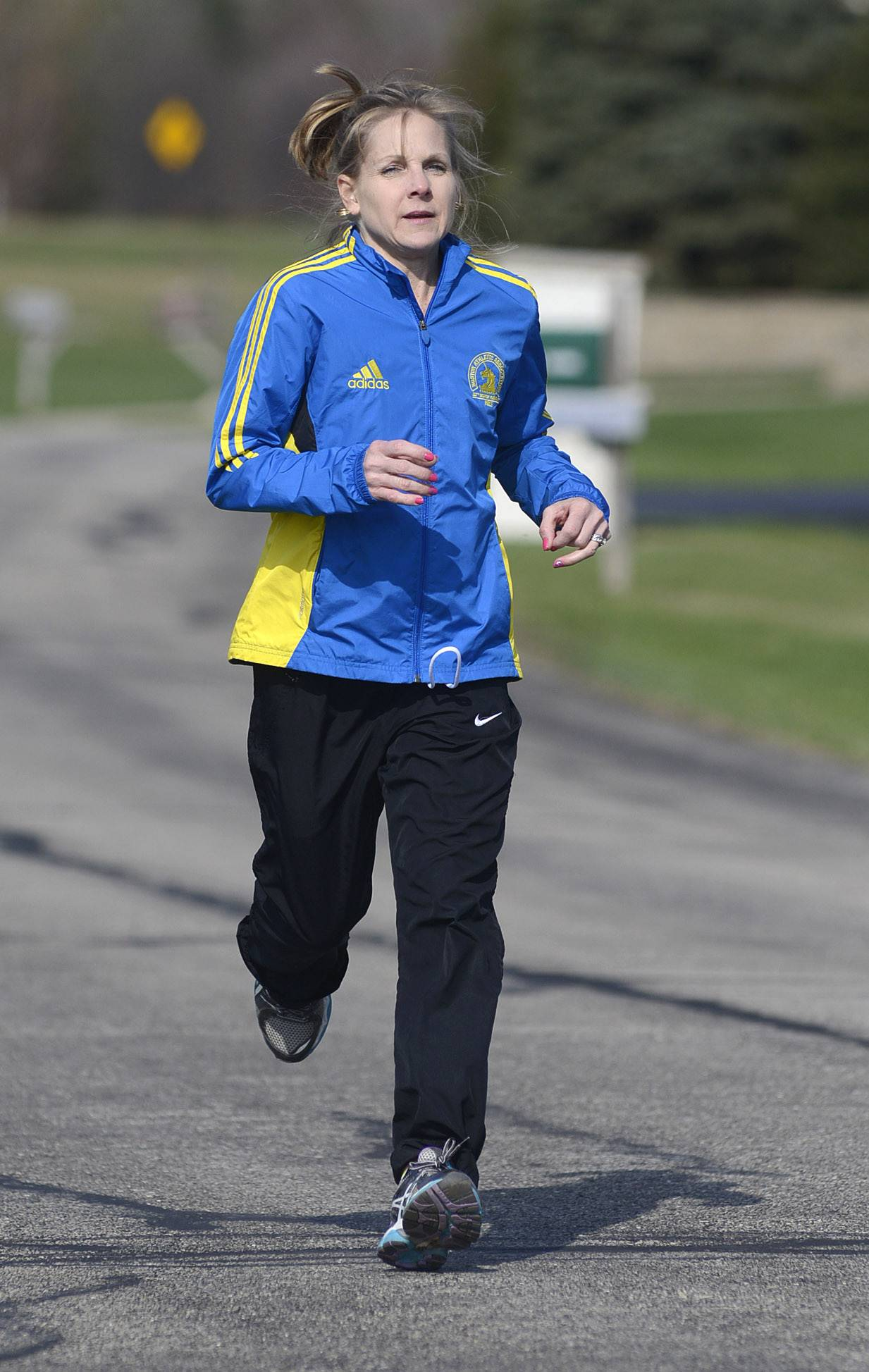 Sue Gruner of Burlington crossed the finish line in last year's Boston Marathon just seconds before the first of two terrorist bombs exploded. Injuries kept her from returning for this year's race.