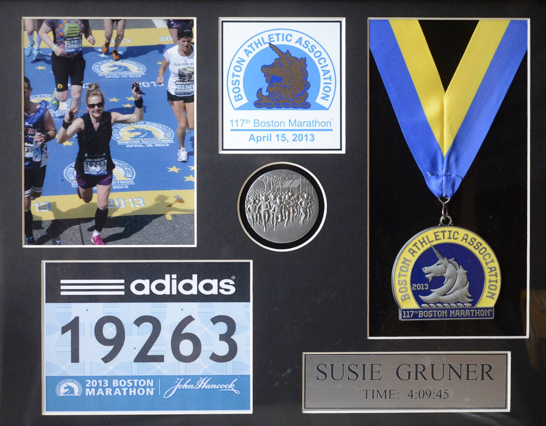 Sue Gruner has framed her memorabilia from the 117th Boston Marathon in 2013.