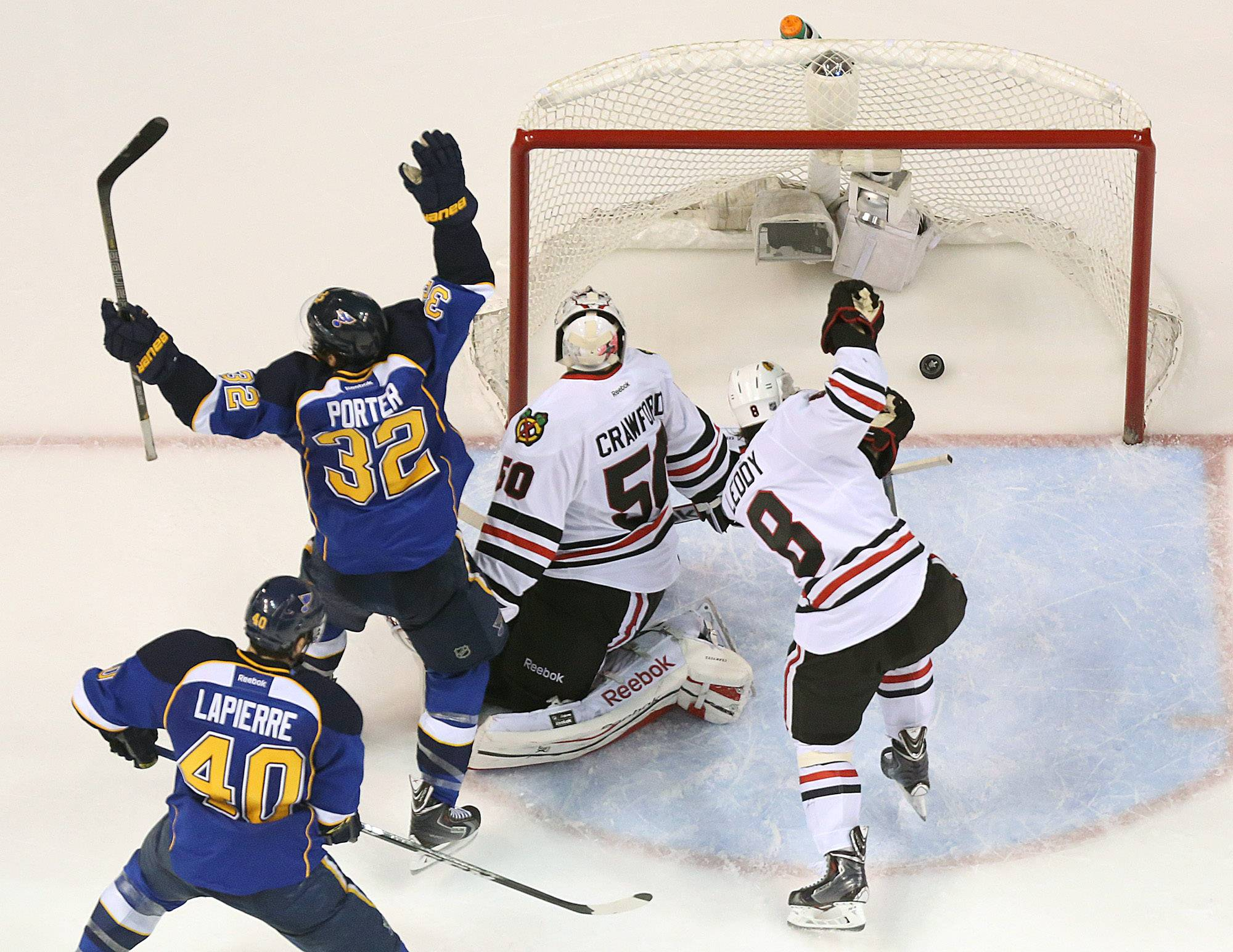 St. Louis Blues left wing Chris Porter (32) reacts after teammate Barret Jackman scored the game-winning goal in overtime past Chicago Blackhawks goaltender Corey Crawford during Game 2 of a first-round NHL hockey playoff series on Saturday in St. Louis. The Hawks who are down two games in the playoff series play the Blues tonight at 7:30.